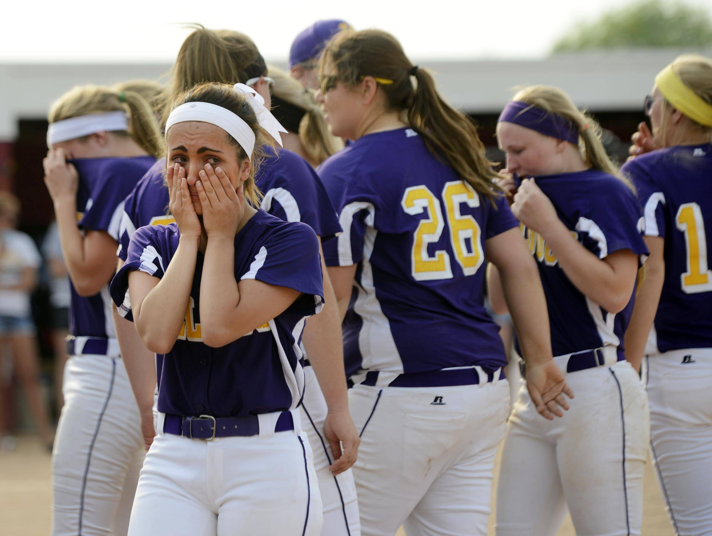 Wauconda's Marissa Honeyman wipes her eyes as the team leaves the field after losing to Sterling in the Class 3A Barrington supersectional Monday.