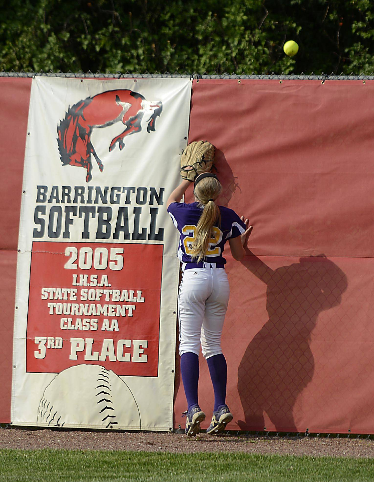 Wauconda's Paige Motley watches a 2-run home run off the bat of Sterling's Nadia Trujillo go over the fence in the Class 3A Barrington supersectional Monday.