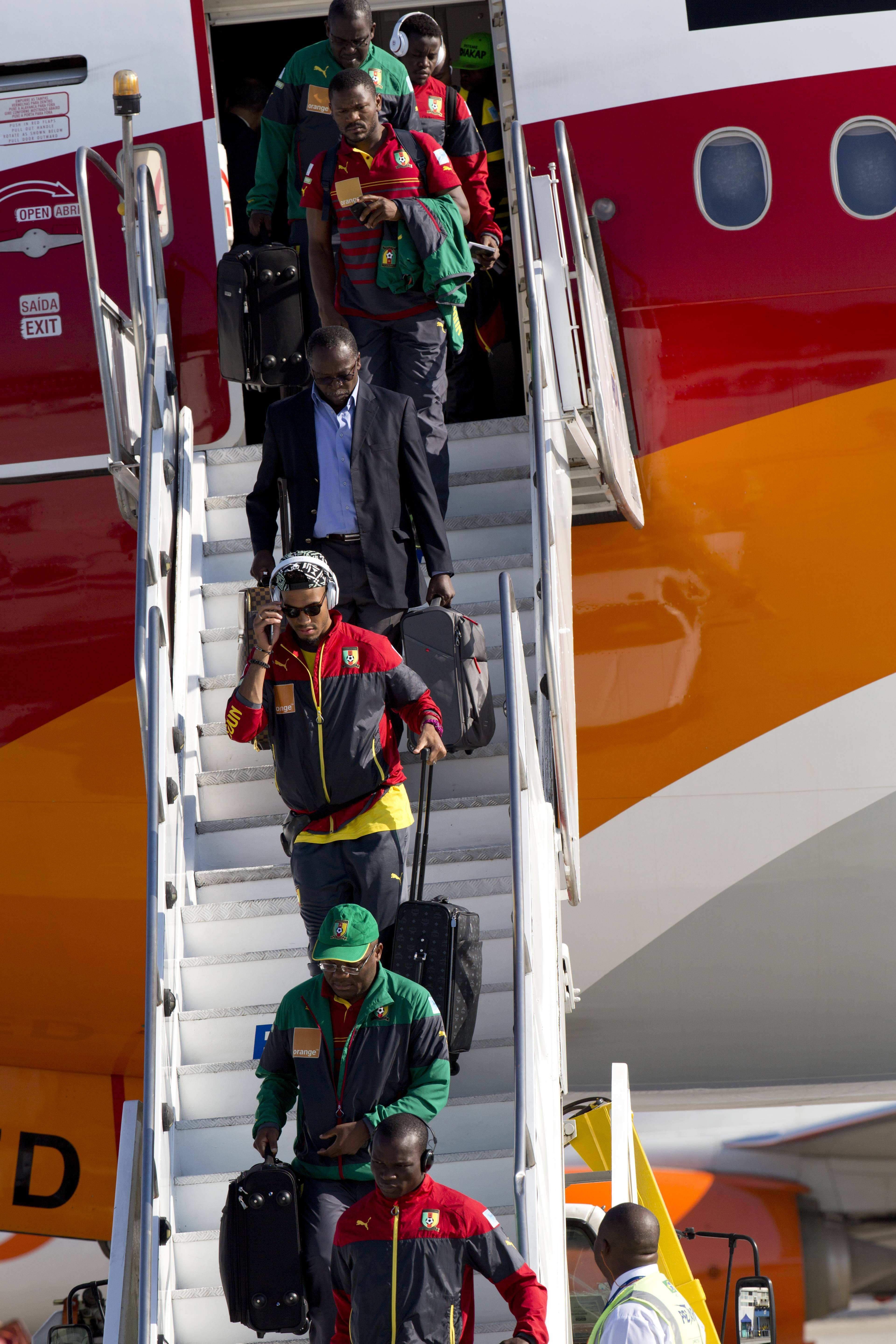 Cameroon national team players arrive Monday at the Galeao Air Base in Rio de Janeiro, Brazil. The team refused to board a plane on Sunday because of a long-running dispute over bonus payments for the World Cup, forcing their national federation to take out a loan to meet their demands.