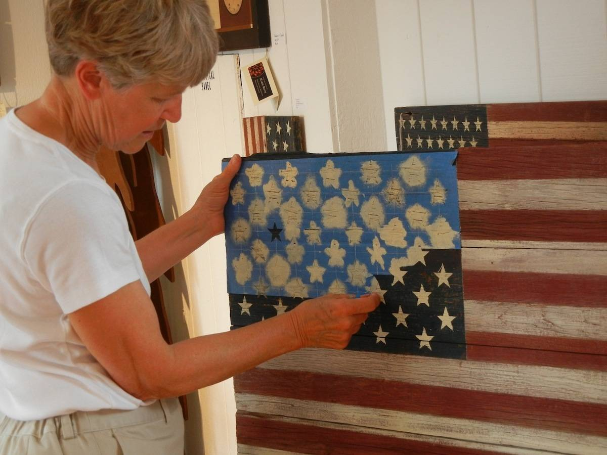 Old Glory in Barnwood , 2-3PM June 14.The Artists Guild, sponsored by the Long Grove Arts & Music Council, will present a program featuring a tribute to Old Glory. Marie Roth will recount the story behind her reclaimed barnwood flags, stories of the barn owners and their families. Together they tell the story of how we became this Union.Marie will offer visitors the opportunity to stencil a star on a flag and sign the back with a message of appreciation. This flag will then be presented to Gunnery Sergeant Joshua Nordstrom, USMC, an Iraq War veteran.The Long Grove Artists Guild Gallery is located in Fountain Square, upstairs from the Potpourri shop. Weather permitting, the program will be outside by the fountain, so bring a lawn chair! Light Refreshments will be available.For more information, please contact Marie Roth: MsWayCool@aol.comGeorgia Cawley