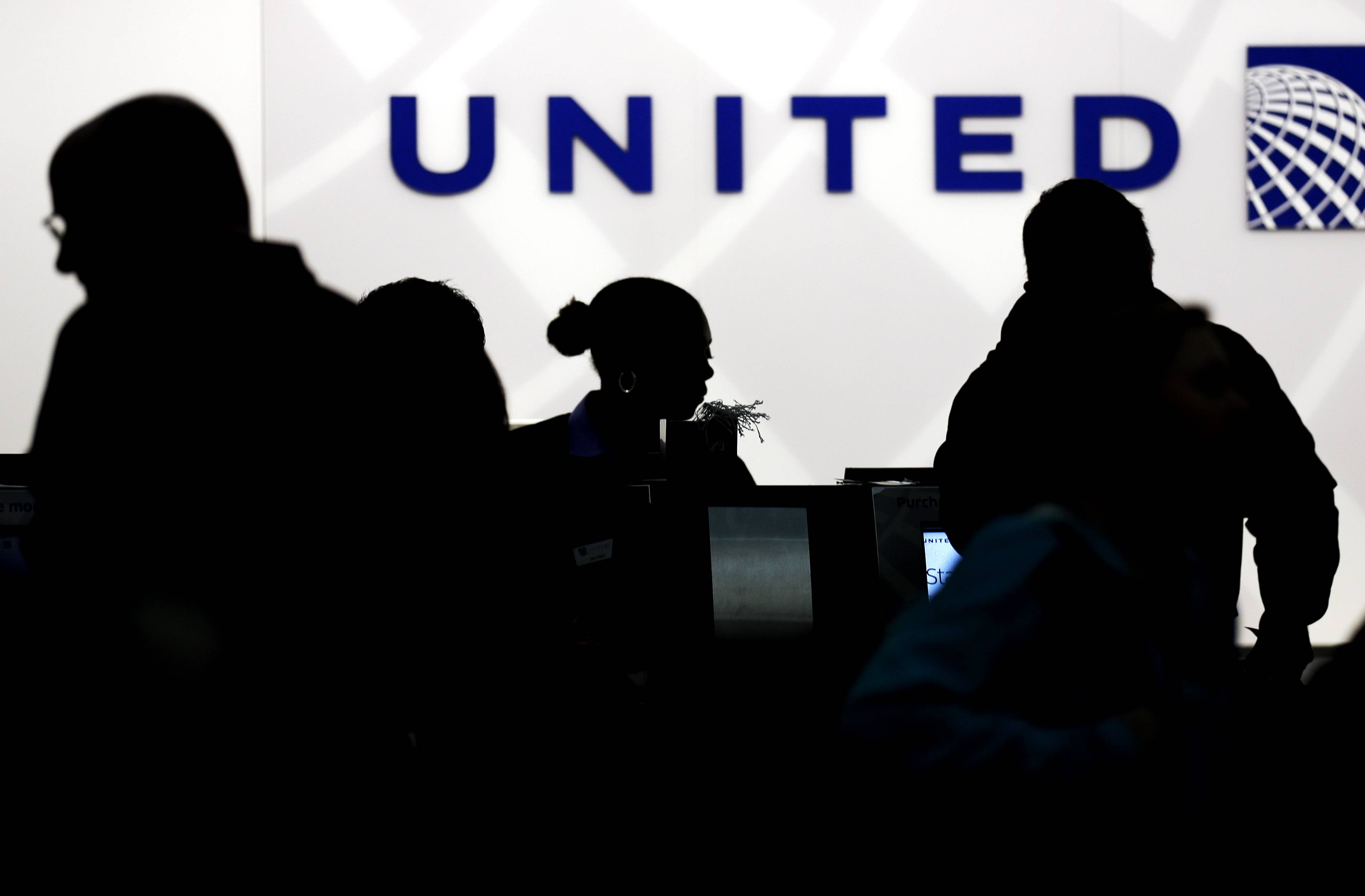Associated Press/Dec. 21, 2013 Travelers check in at the United Airlines ticket counter at Terminal 1 in O'Hare International Airport.