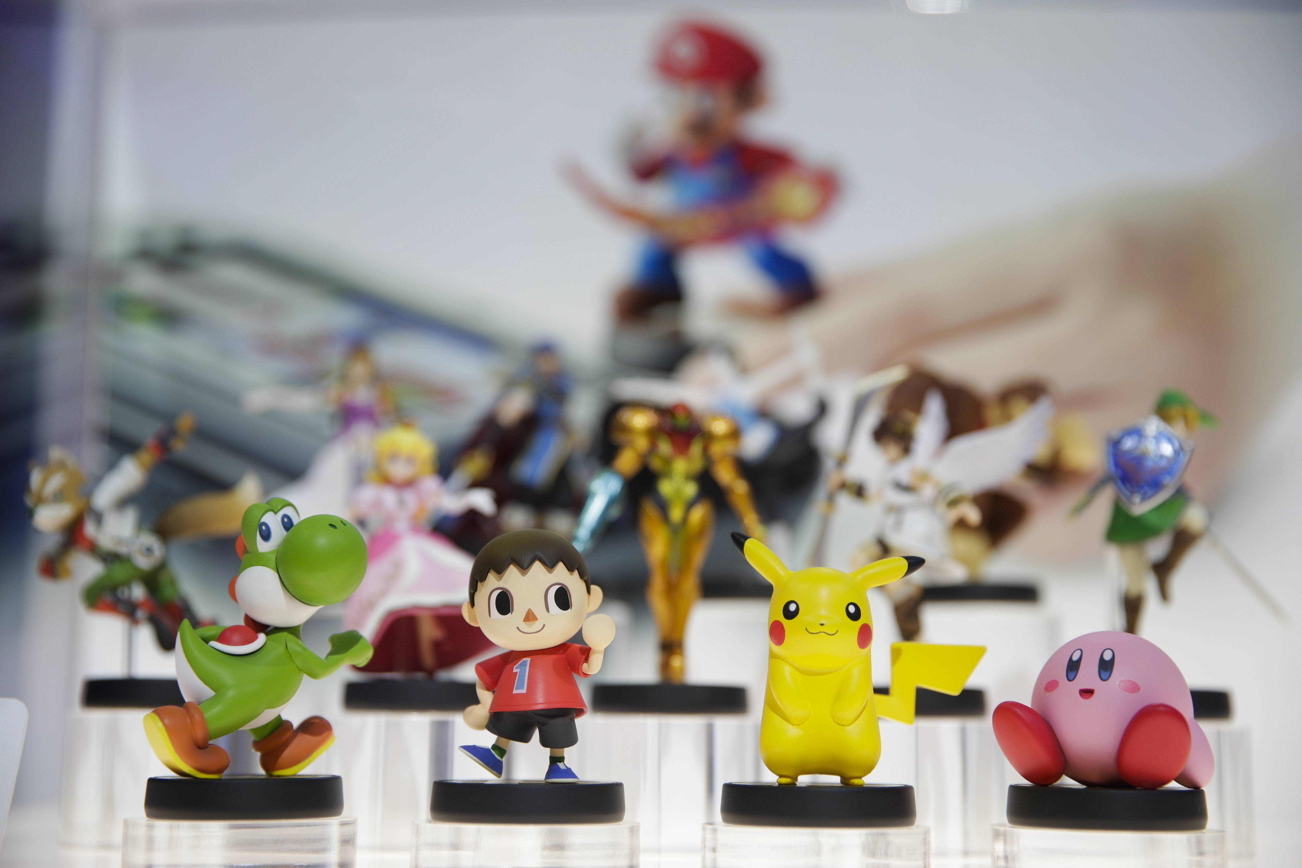Amiibo characters for Wii U are on display at the Nintendo booth Tuesday during the Electronic Entertainment Expo in Los Angeles.