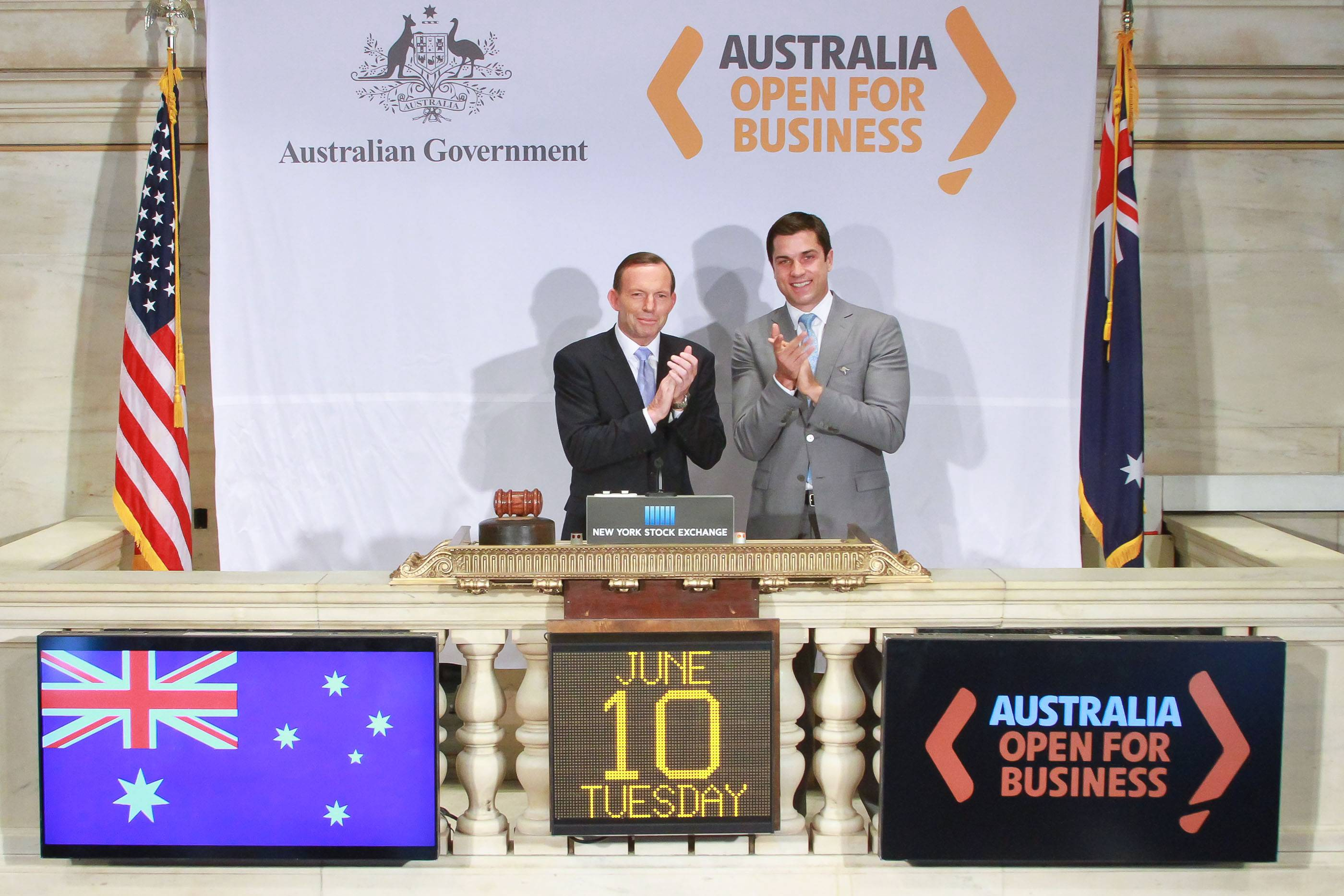 NYSE Euronext, Australian Prime Minister Tony Abbott, left, applauds Tuesday during the opening bell ceremony at the New York Stock Exchange in New York.