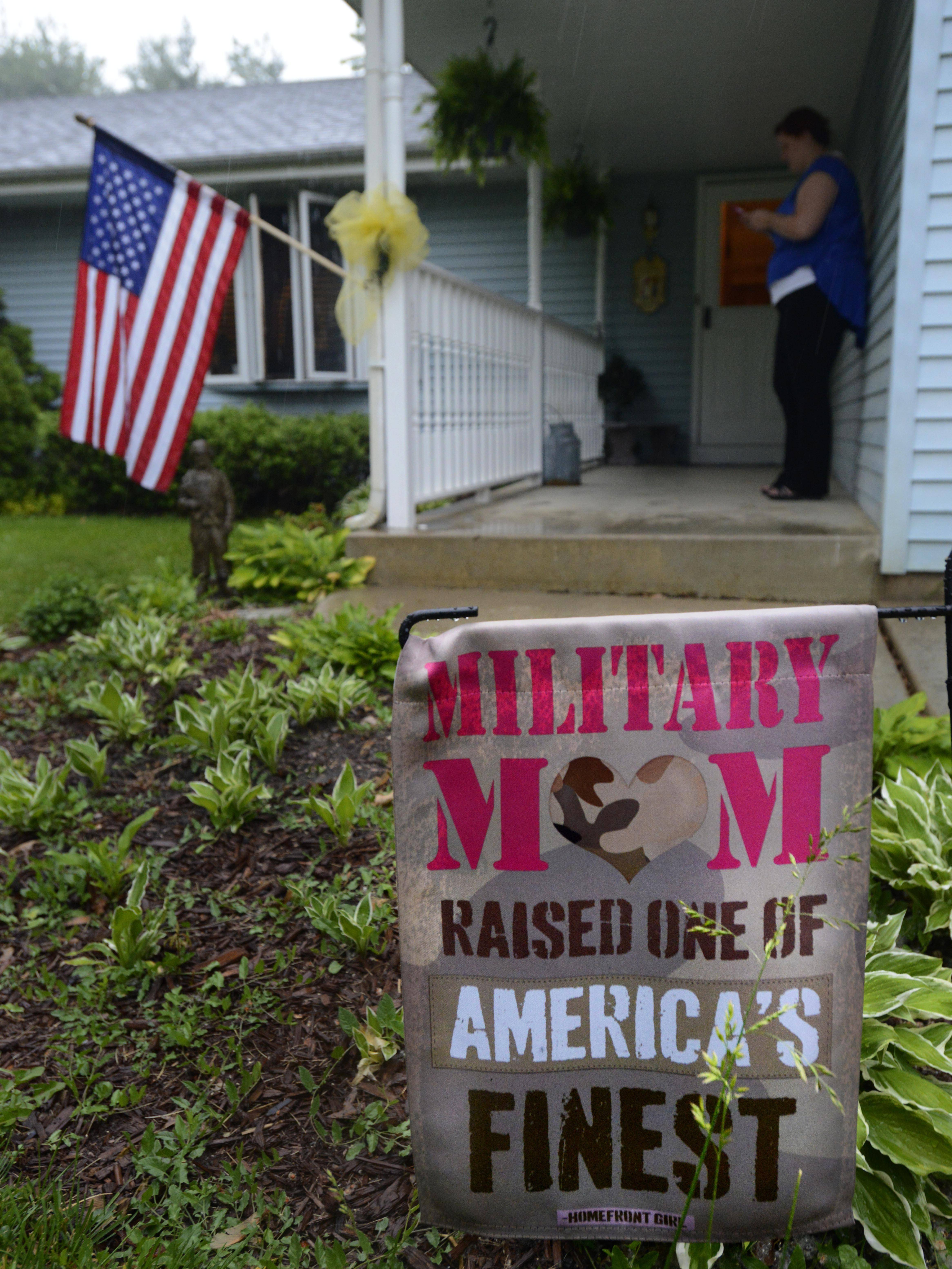 A sign stands outside the home of Aaron Toppen and his family in Mokena Tuesday. A family spokeswoman told The Associated Press that Topper, 19, was among five American troops killed this week during a friendly fire airstrike in Afghanistan.