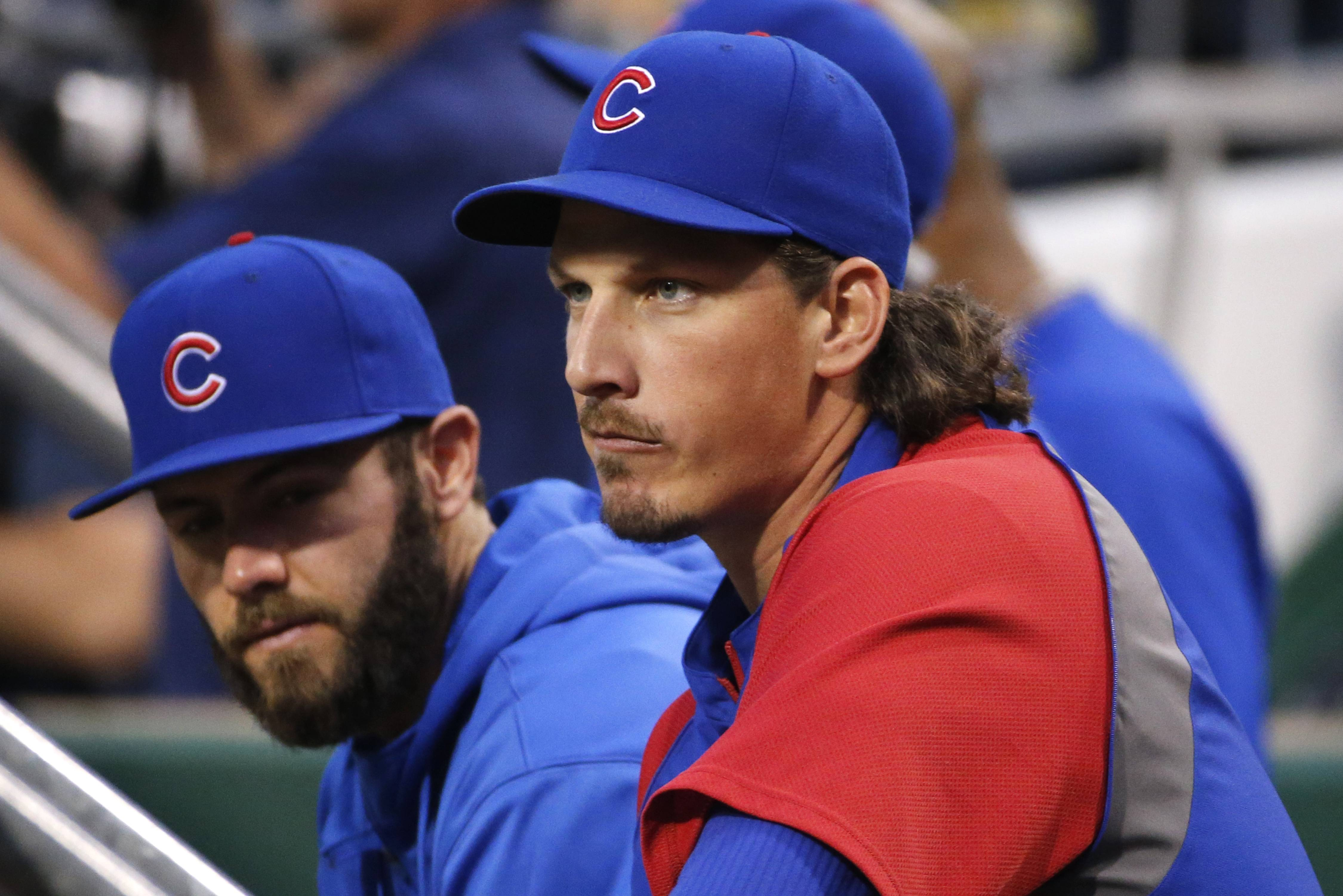 Maybe the Cubs shouldn't move so fast to either trade starting pitcher Jeff Samardzija, at right, or sign him to a long-term contract.