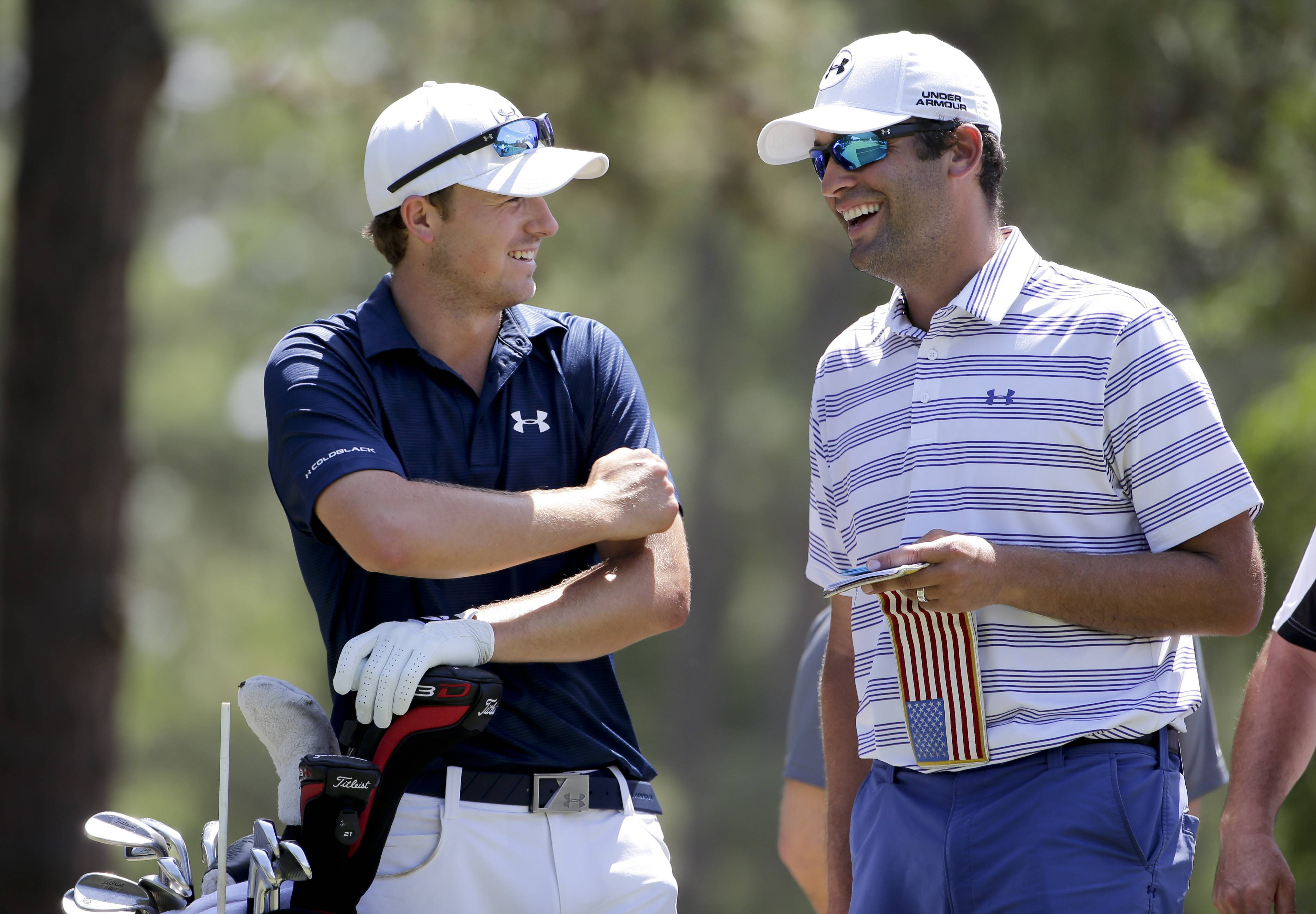 Jordan Spieth, left, and caddie Michael Greller talk on the 14th hole during a practice round for the U.S. Open golf tournament in Pinehurst, N.C., Tuesday, June 10, 2014. The tournament starts Thursday.