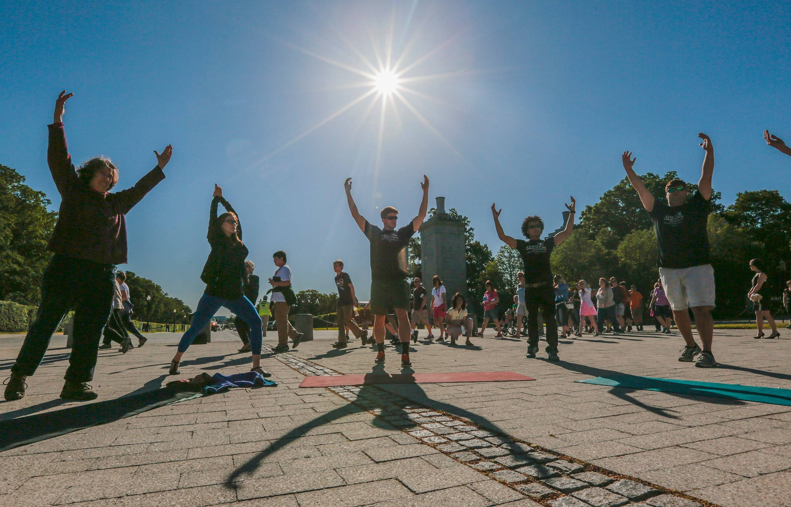 Military veterans and meditation/yoga advocates get together last month at Arlington National Cemetery's Women's Memorial.