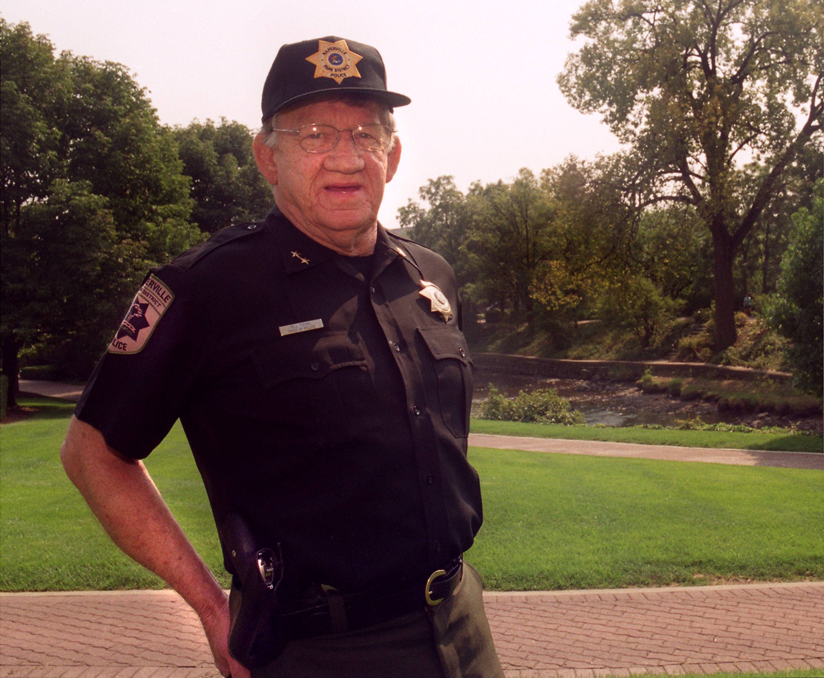 Bill Young of Naperville is being remembered for creating the Naperville Park District police force and mentoring generations of students and wrestlers as a teacher, dean and coach at Naperville Central High School. Young, seen here in 2003, will be remembered during a memorial toast June 21 at the Riverwalk Grand Pavilion.