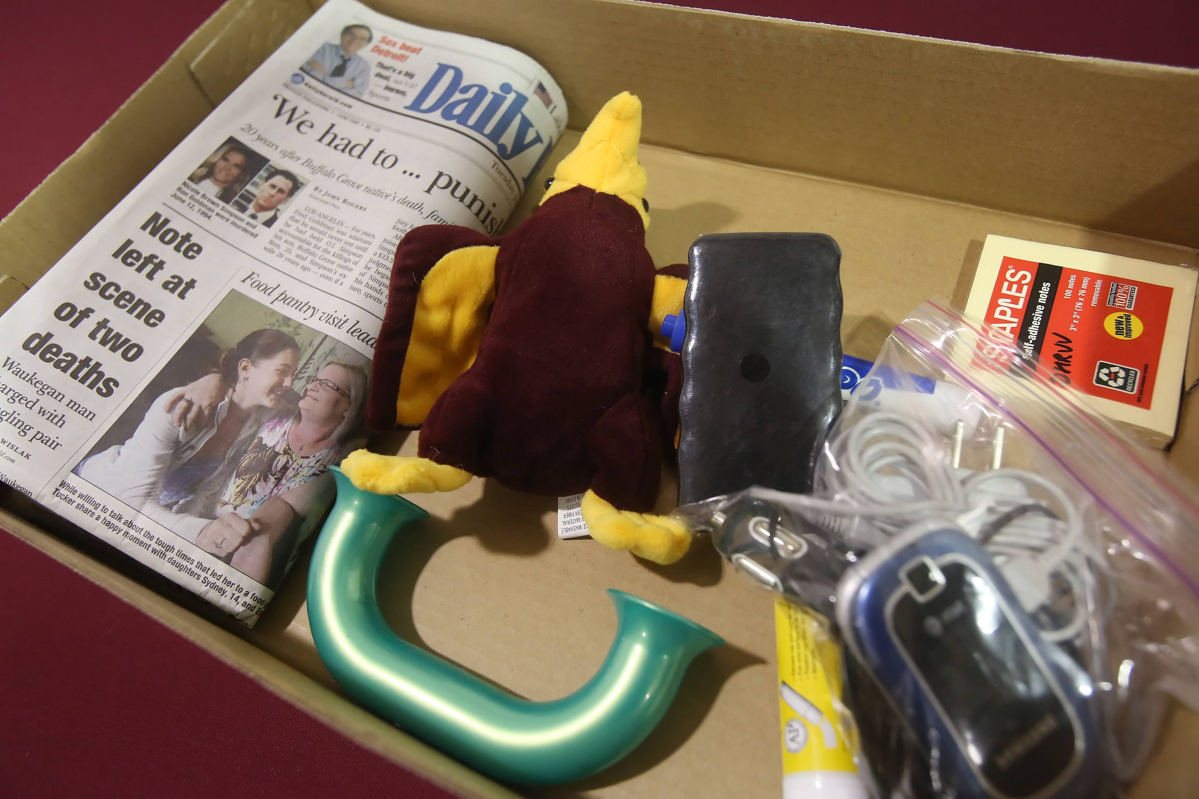 Items to be placed in Rondout Elementary School's time capsule during Tuesday's ceremony include a flash drive, cellphone, newspaper, Post-it's, a Toobaloo and the school mascot Falcon toy. The ceremony culminated the school's 150-year anniversary celebration.
