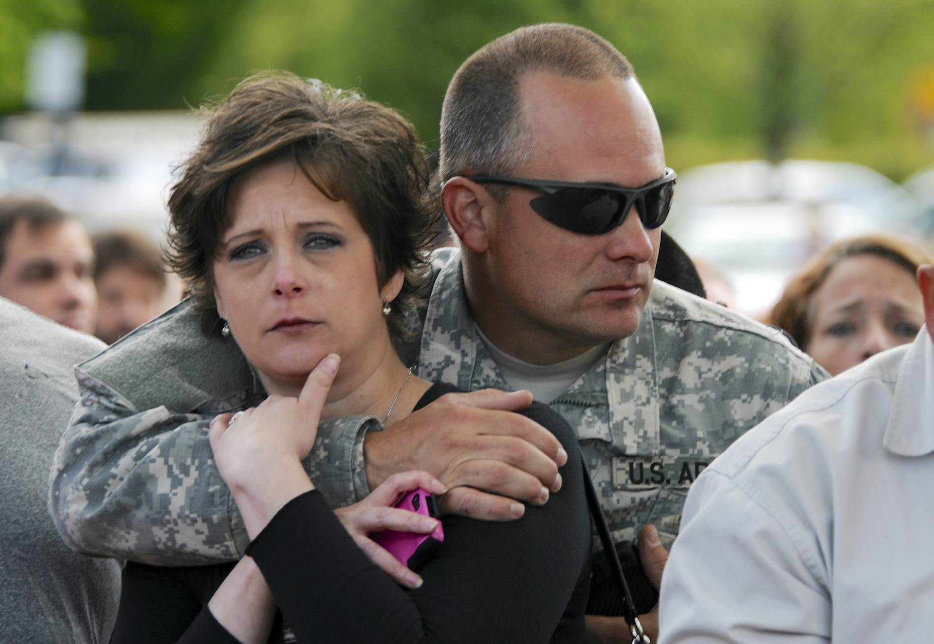 Parents wait at the Fred Meyer grocery store parking lot Tuesday in Wood Village, Ore., to be reunited with students after a shooting at Reynolds High School.