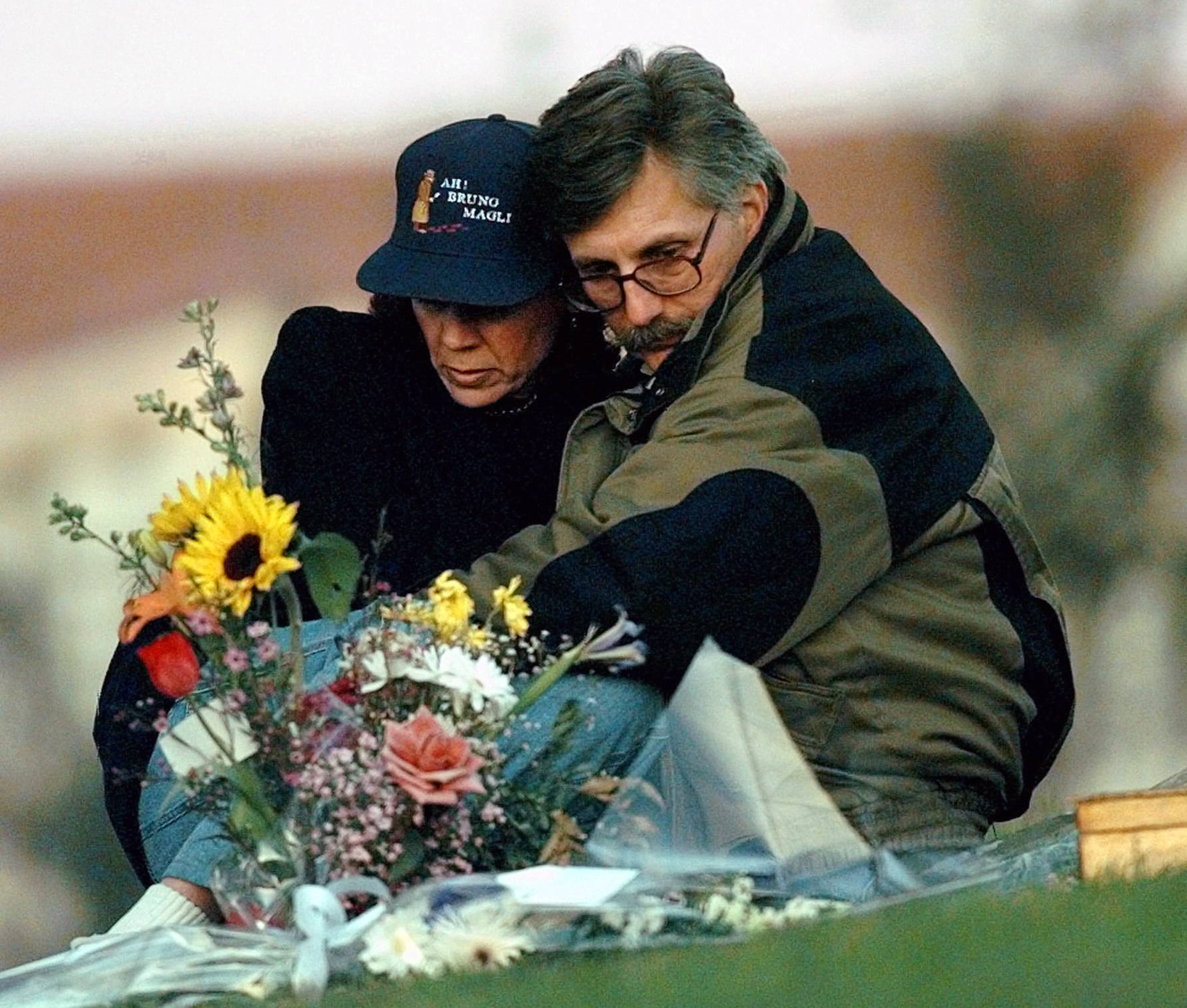 In this Feb. 5, 1997 file photo, Fred Goldman and his wife, Patti, sit quietly at the grave of their son Ronald Goldman in Valley Oaks Memorial Park in Westlake Village, Calif. Fred Goldman hasn't rested since a jury acquitted O.J. Simpson in the murder case 20 years ago. Simpson pulled a hotel-room stickup in Las Vegas in 2007 to recover his sports memorabilia before Goldman could get it, an act that landed him in prison for as long as 33 years.