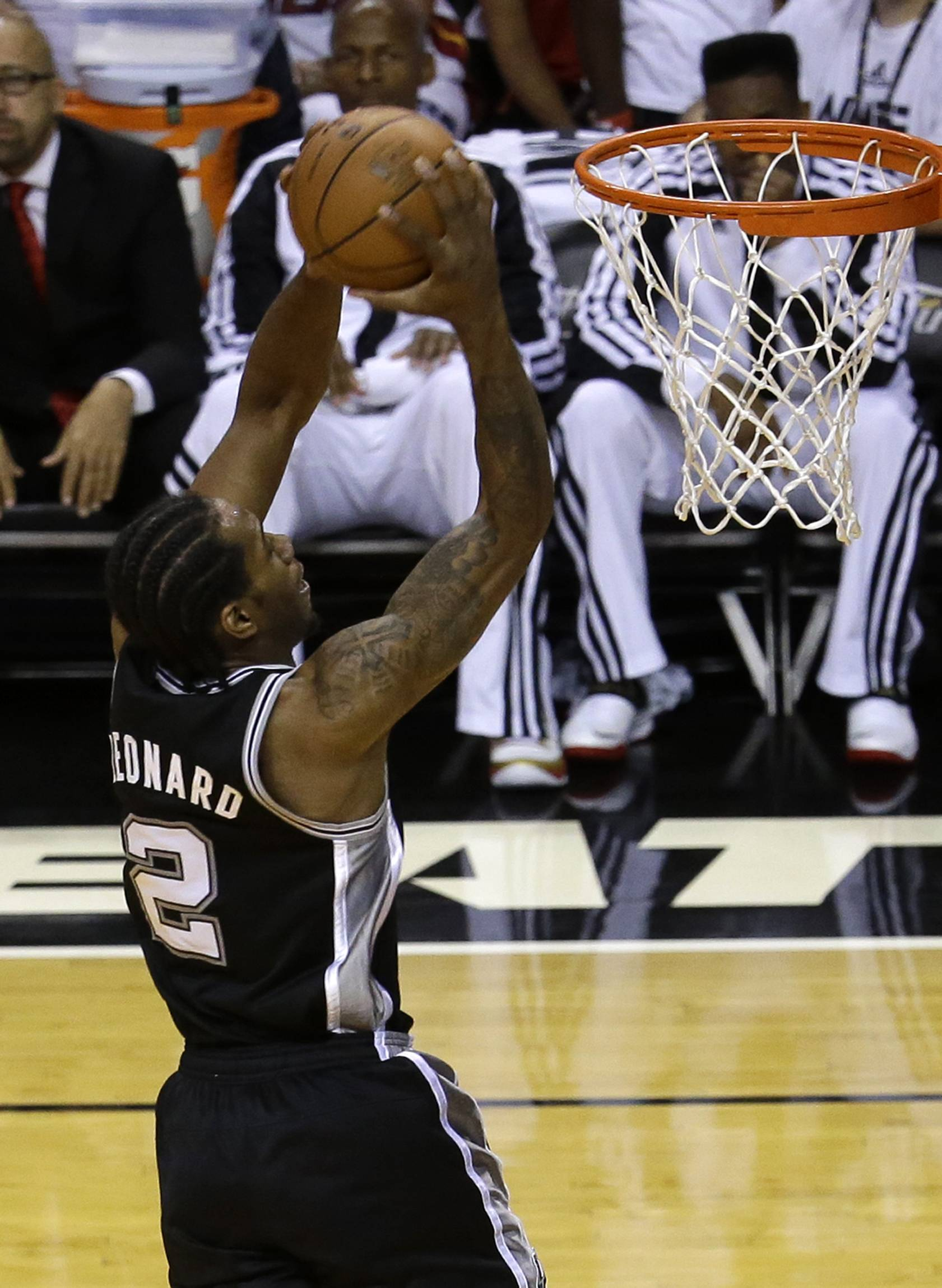 San Antonio Spurs forward Kawhi Leonard (2) goes to the basket against the Miami Heat in Game 3 of the NBA basketball finals Tuesday night in Miami. The Spurs won 111-92.