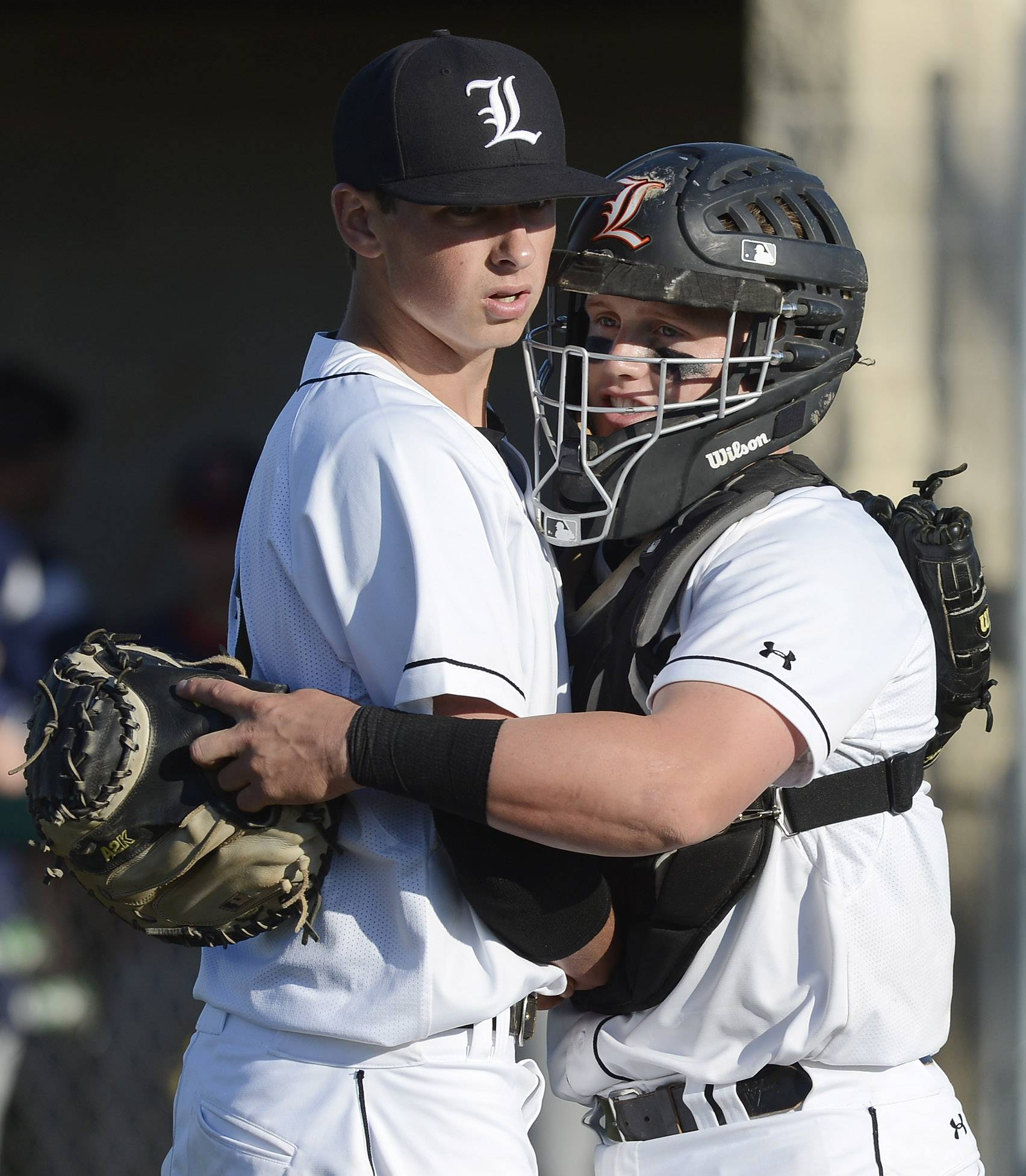 Libertyville pitcher Jeff Barton gets a hug from catcher Matt Reed after defeating St. Viator 7-2 during the Class 4A baseball sectional semifinal at Glenbrook South Wednesday.