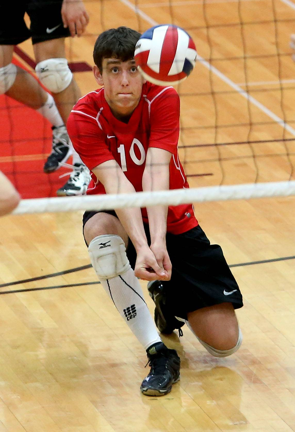 Naperville Central's Jon Chiczewski gets to the ball in action against Glenbard West during the boys volleyball sectional championship at Hinsdale Central on Tuesday.