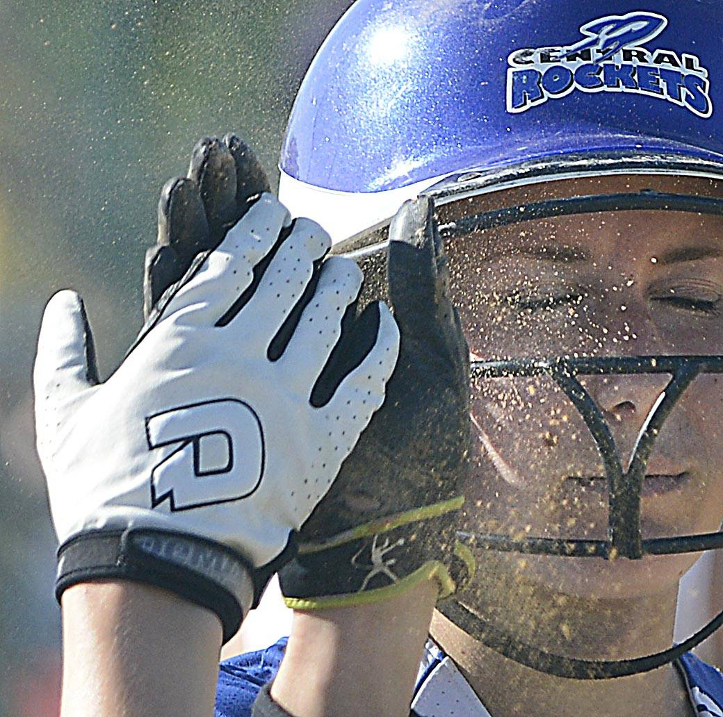 Dust sprays in the eyes of Burlington Central's Courtni Neubauer as she high fives teammate Emily Kisch after scoring against Sterling Tuesday in the Class 3A Marengo sectional semifinal game.