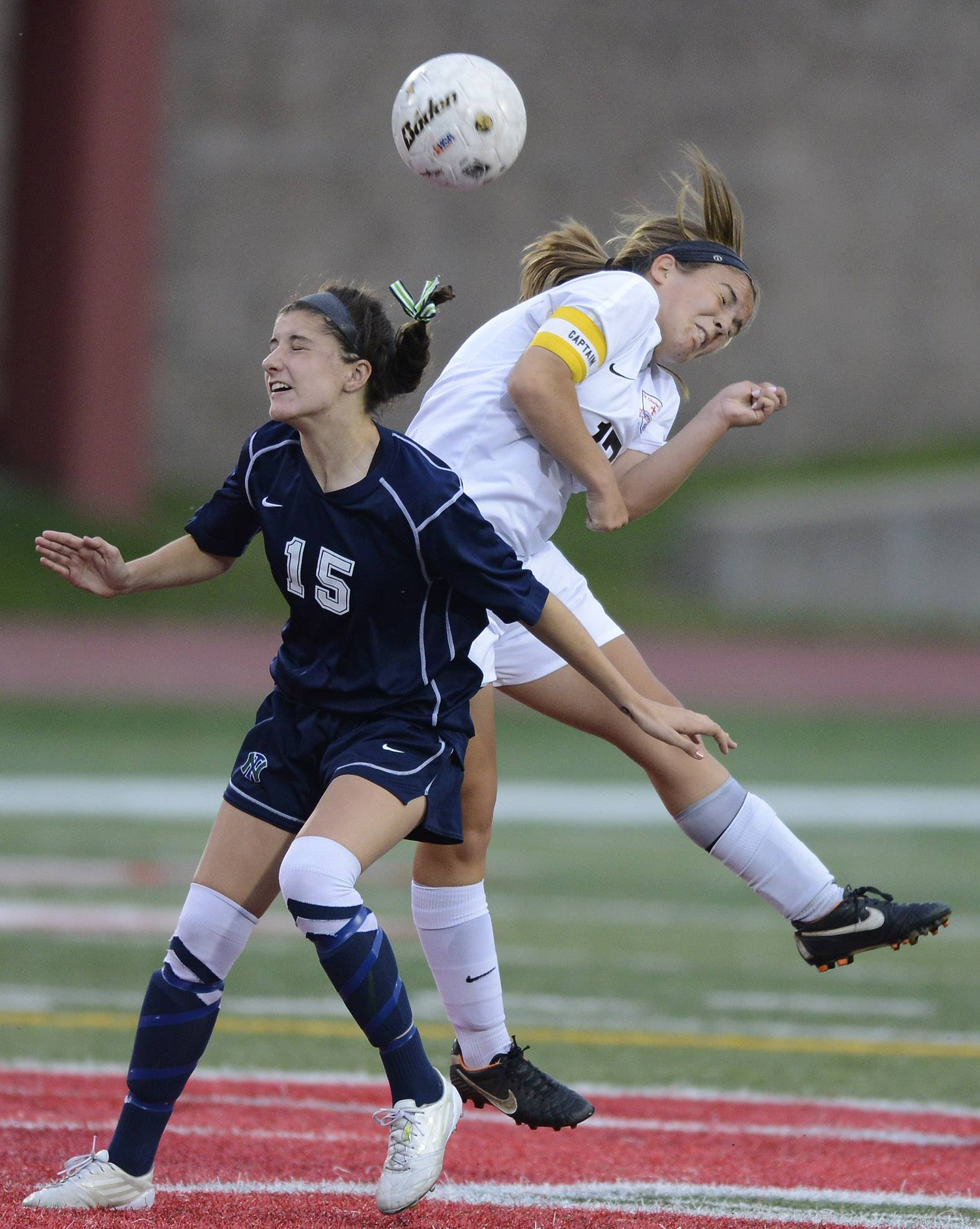 Celia Frei, left, of New Trier and Amanda Hilton of St. Charles East battle for position on a header during the girls soccer Class 3A state final at North Central College in Naperville Saturday.