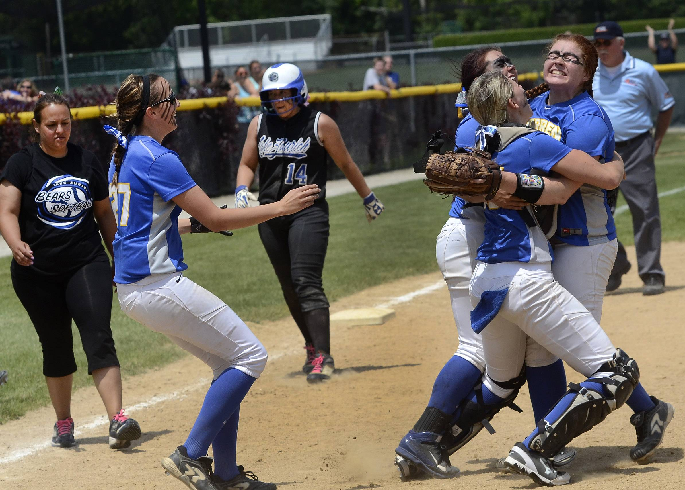 Warren players celebrate after capturing the Class 4A Stevenson softball sectional title over Lake Zurich.