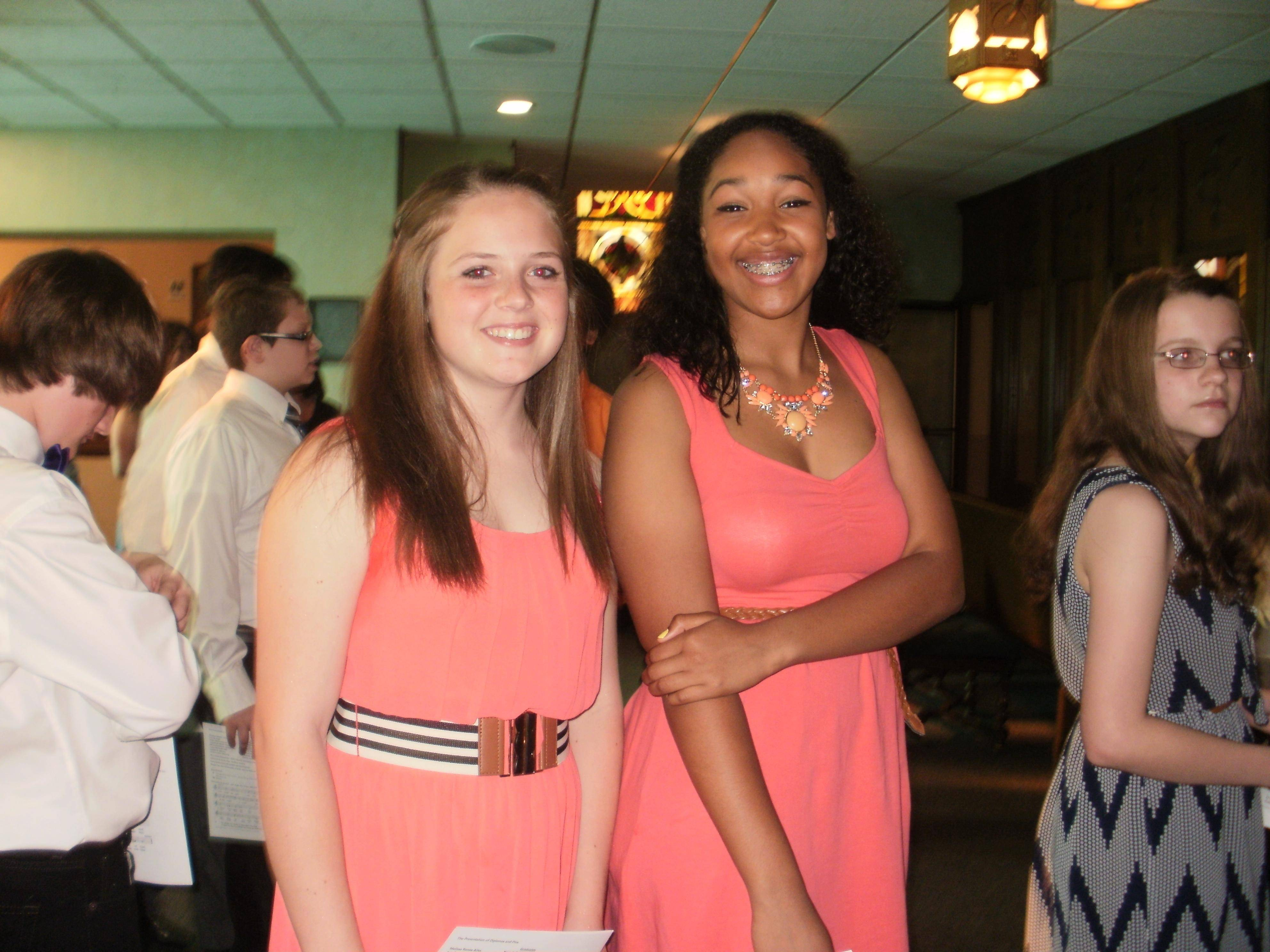 Michaela Gundersen and Erika Burns graduate from eighth grade at St. John Lutheran School in Elgin.