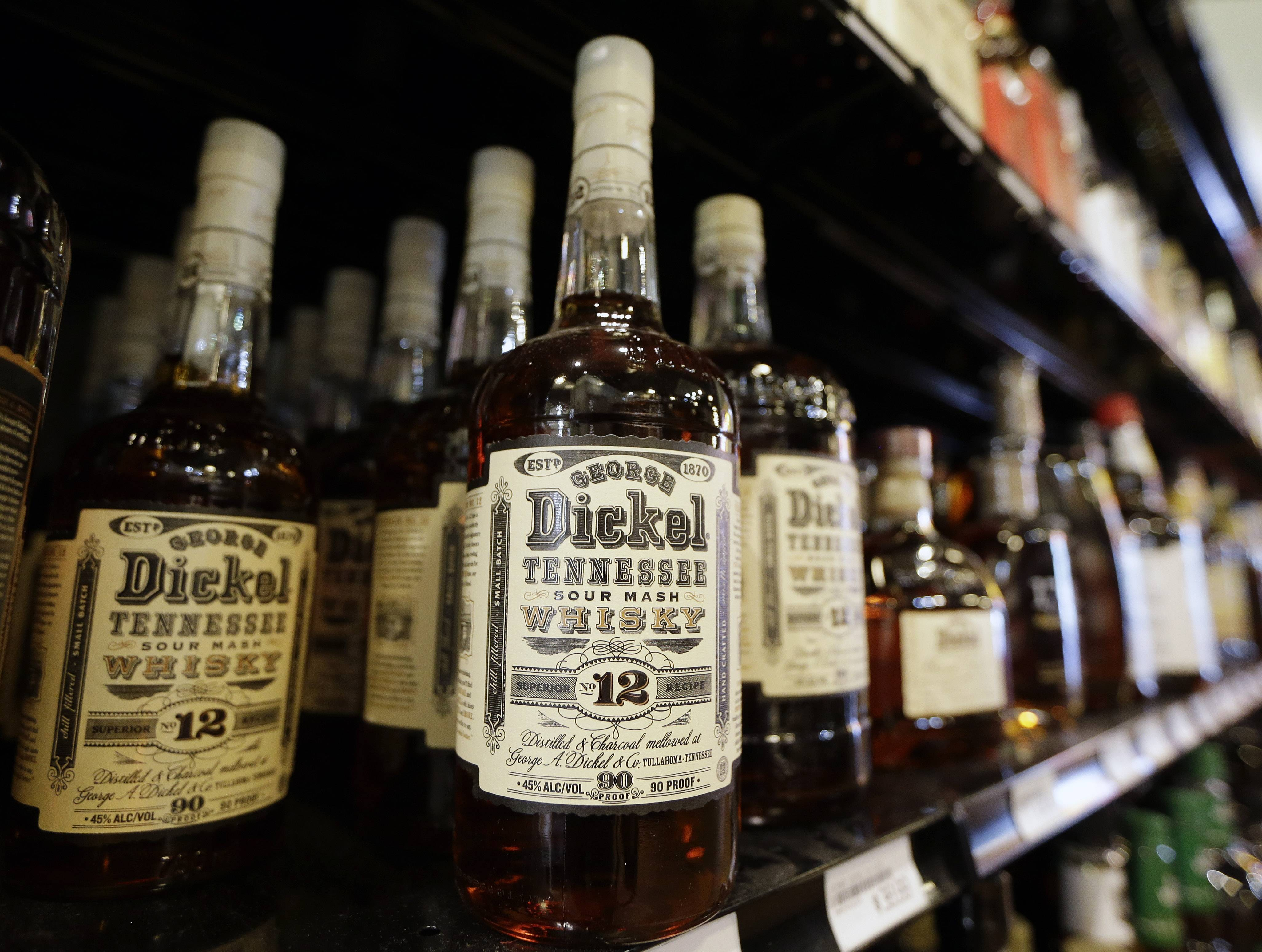 Bottles of George Dickel Tennessee whiskey in a liquor store in Nashville, Tenn. Alcohol regulators ended their investigation into whether George Dickel, a subsidiary of liquor giant Diageo, violated state laws by storing whiskey in neighboring Kentucky.