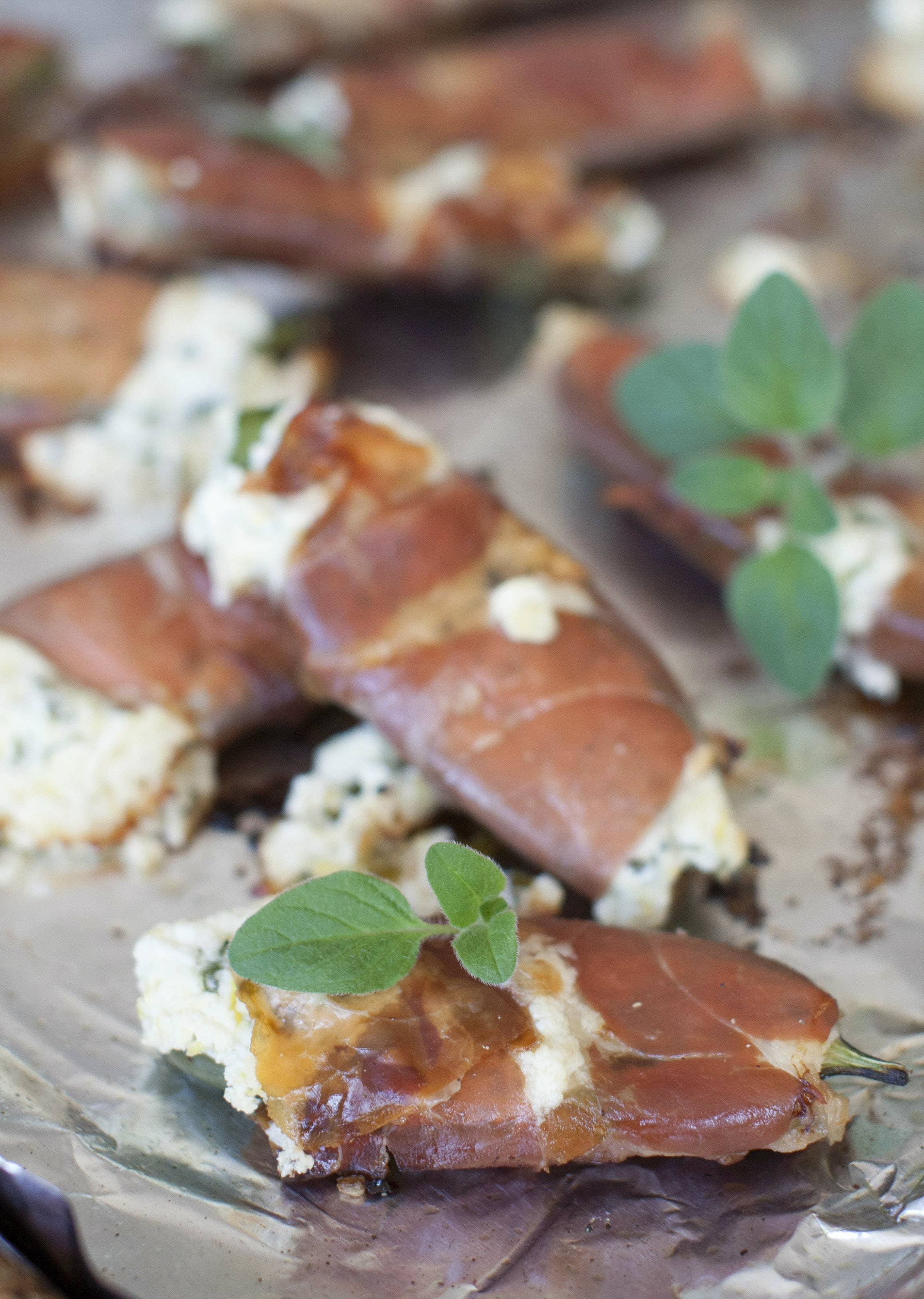 Prosciutto steps in for bacon in these trimmed down, guy-friendly jalapeño poppers.