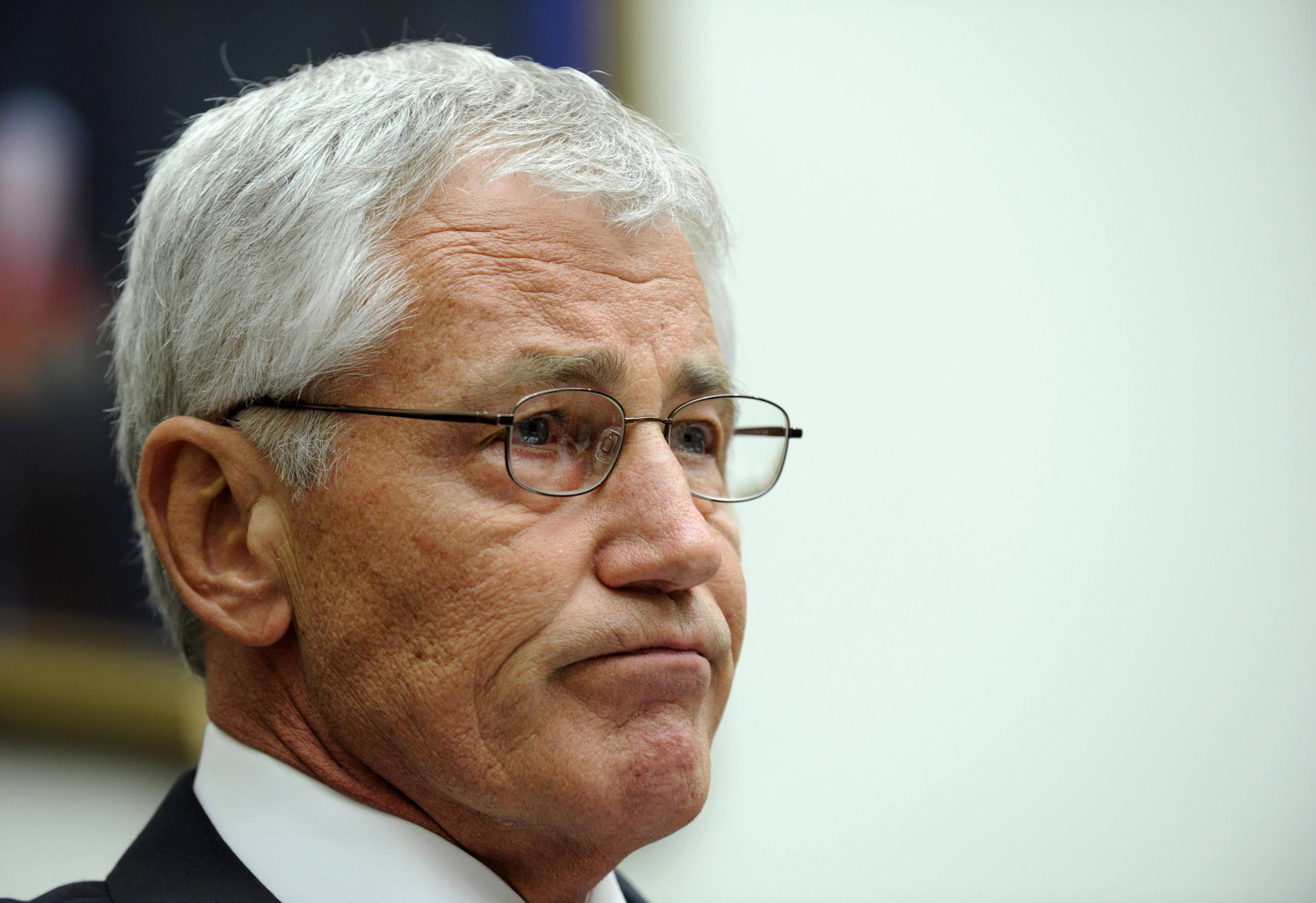 Defense Secretary Chuck Hagel listens while testifying on Capitol Hill in Washington, Wednesday, June 11, 2014, before the House Armed Services Committee. Hagel faced angry lawmakers as the first Obama administration official to testify publicly about the controversial prisoner swap with the Taliban.