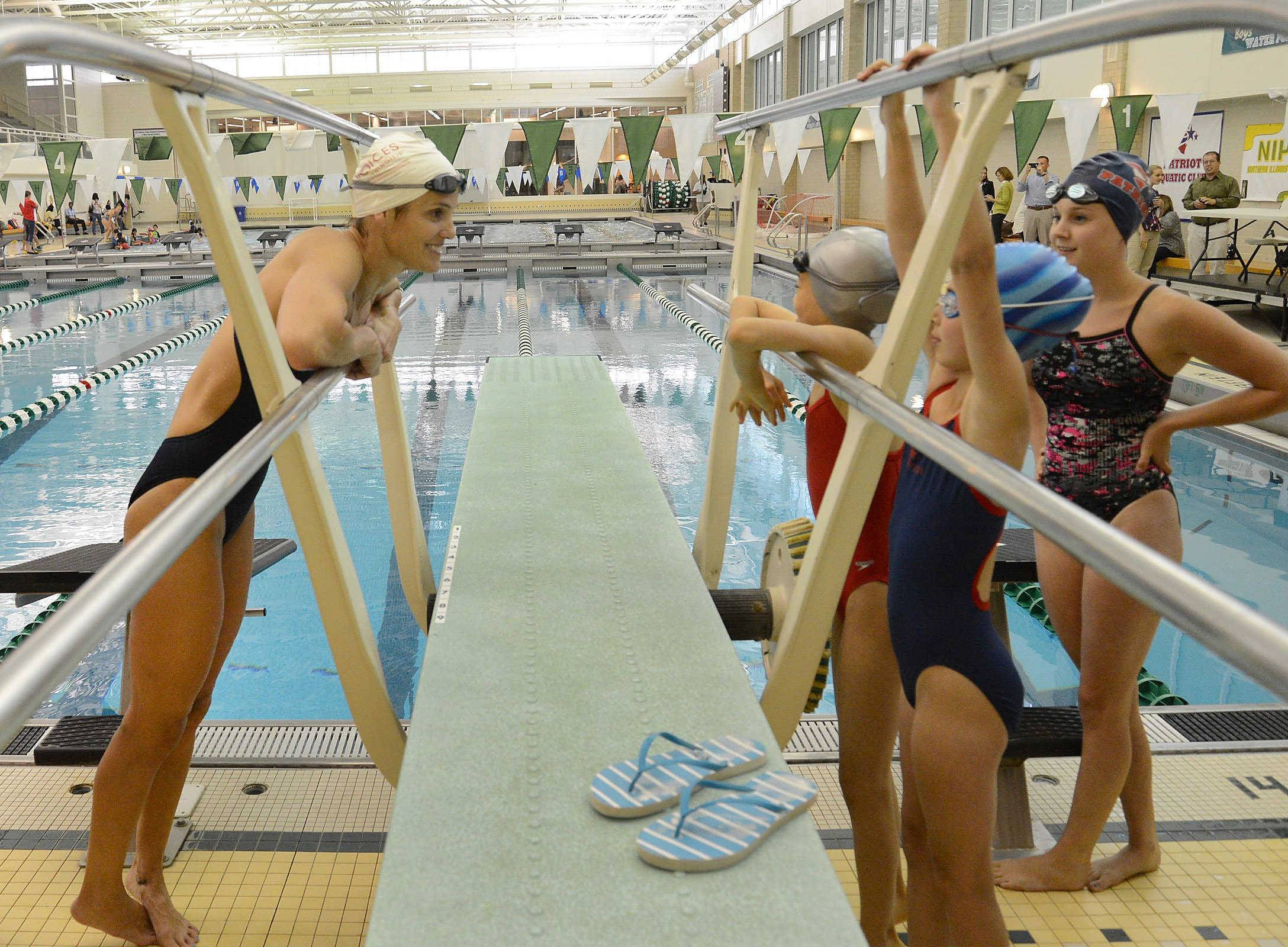 Ex-Olympian swims with suburban kids at Stevenson