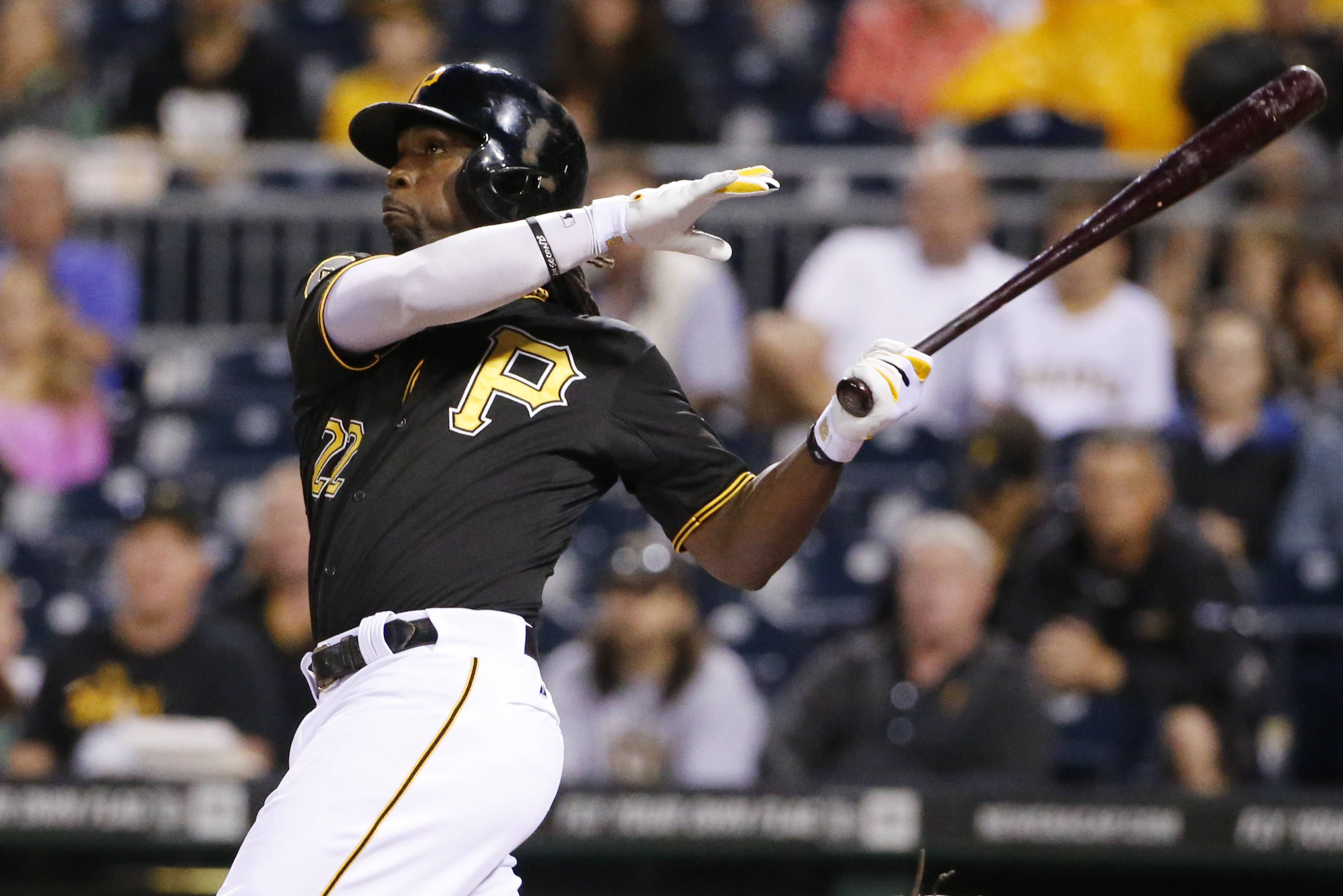 Pittsburgh Pirates' Andrew McCutchen (22) hits a two-run home run off Chicago Cubs starting pitcher Jason Hammel during the first inning of a baseball game Wednesday in Pittsburgh.