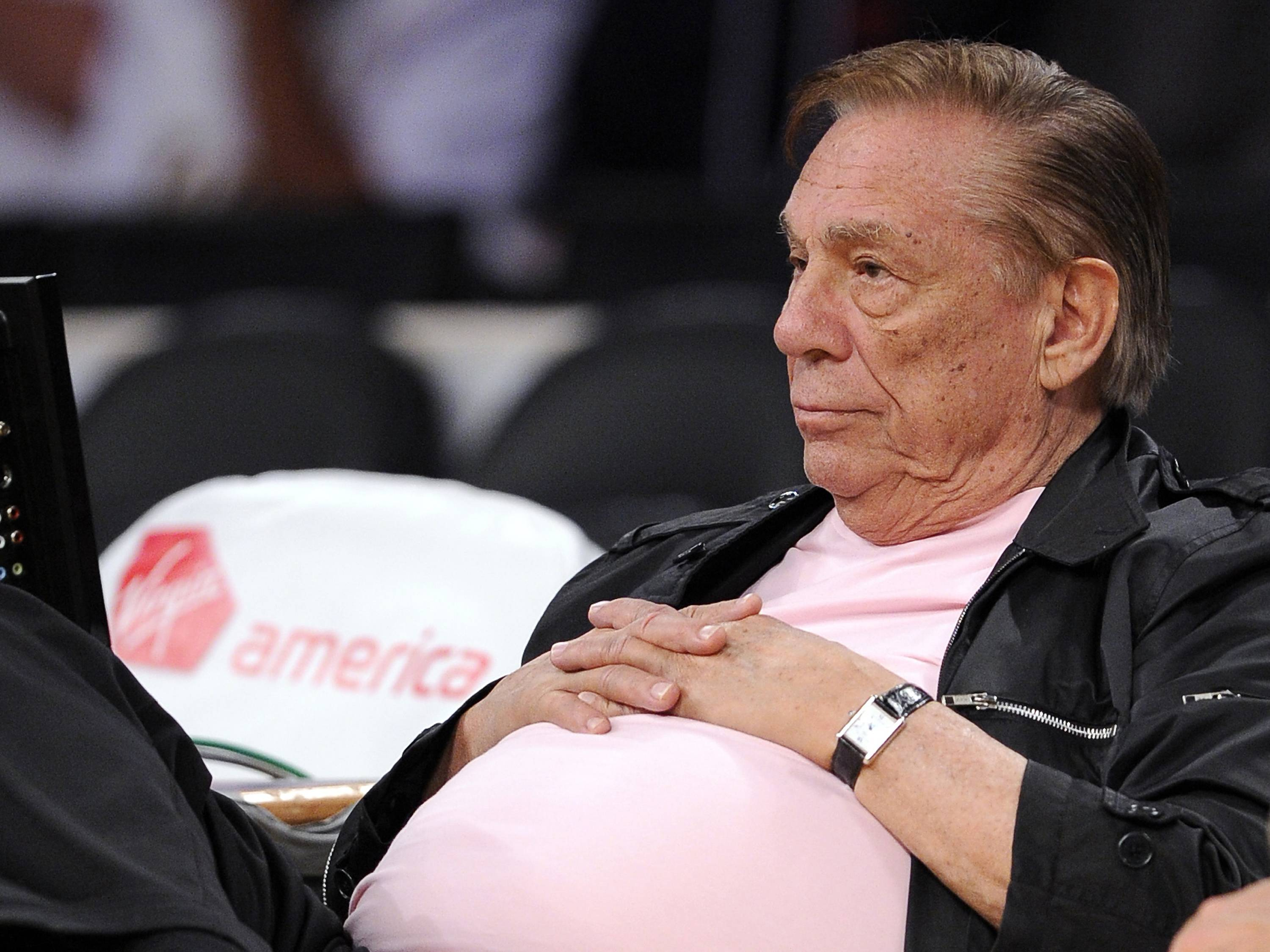 In this Oct. 17, 2010 file photo, Los Angeles Clippers team owner Donald Sterling watches his team play in Los Angeles. Sterling has pulled his support from a deal to seel the team he has owned for 33 years to former Microsoft CEO Steve Ballmer for $2 billion. Now his wife Shelly wants a court decide whether she's the sole trustee and can go ahead with sale without her husband's support.