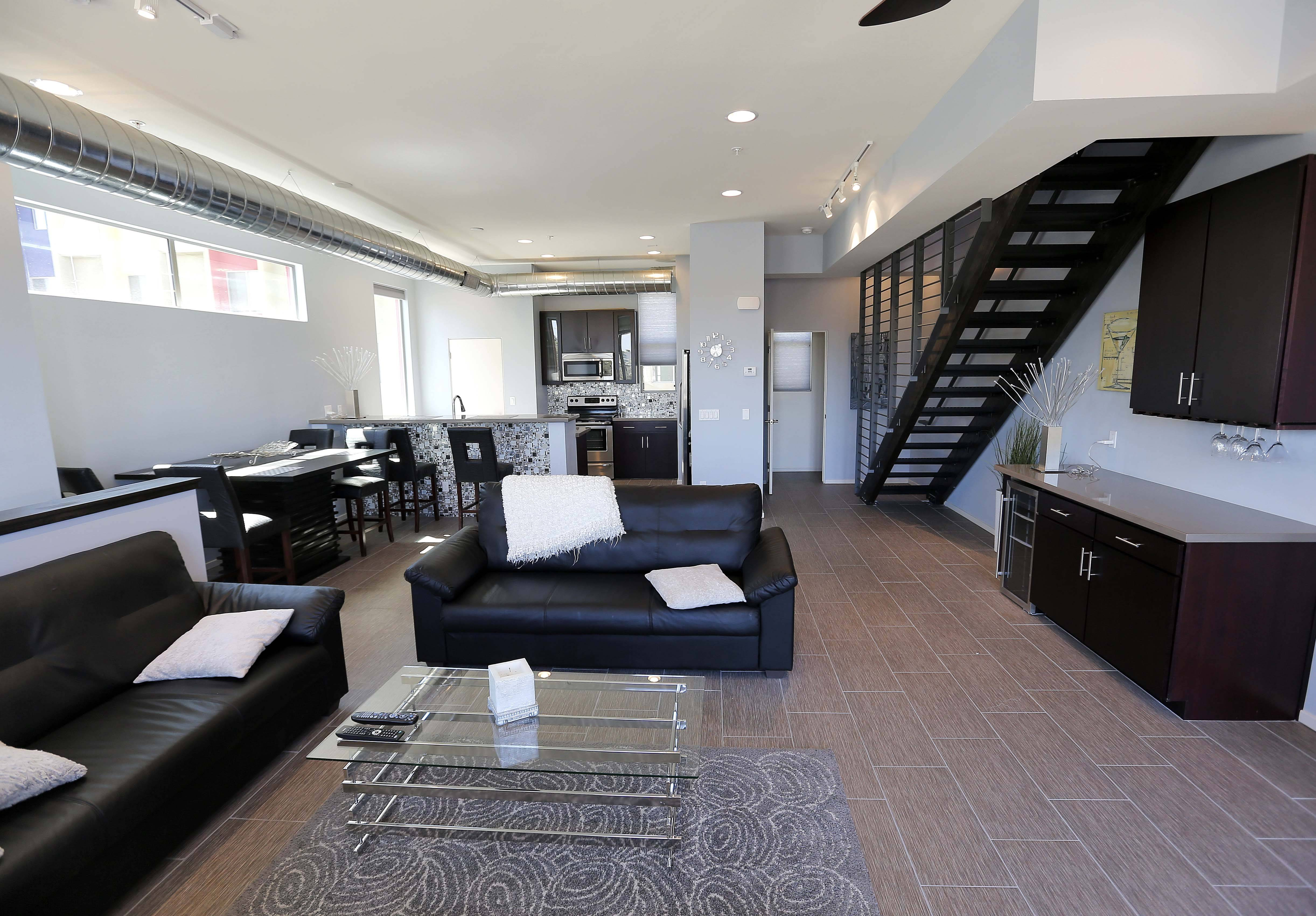 This June 4, 2014 photo shows the interior of attorney Tim Nelson's home at the newly built Portland townhouse development in Phoenix. Americans like Nelson increasingly say they prefer to live near the centers of cities and towns, where commutes tend to be easier and culture, restaurants and entertainment close by. It marks a pronounced shift away from the yearning for open suburban space that drove U.S. home construction for decades.