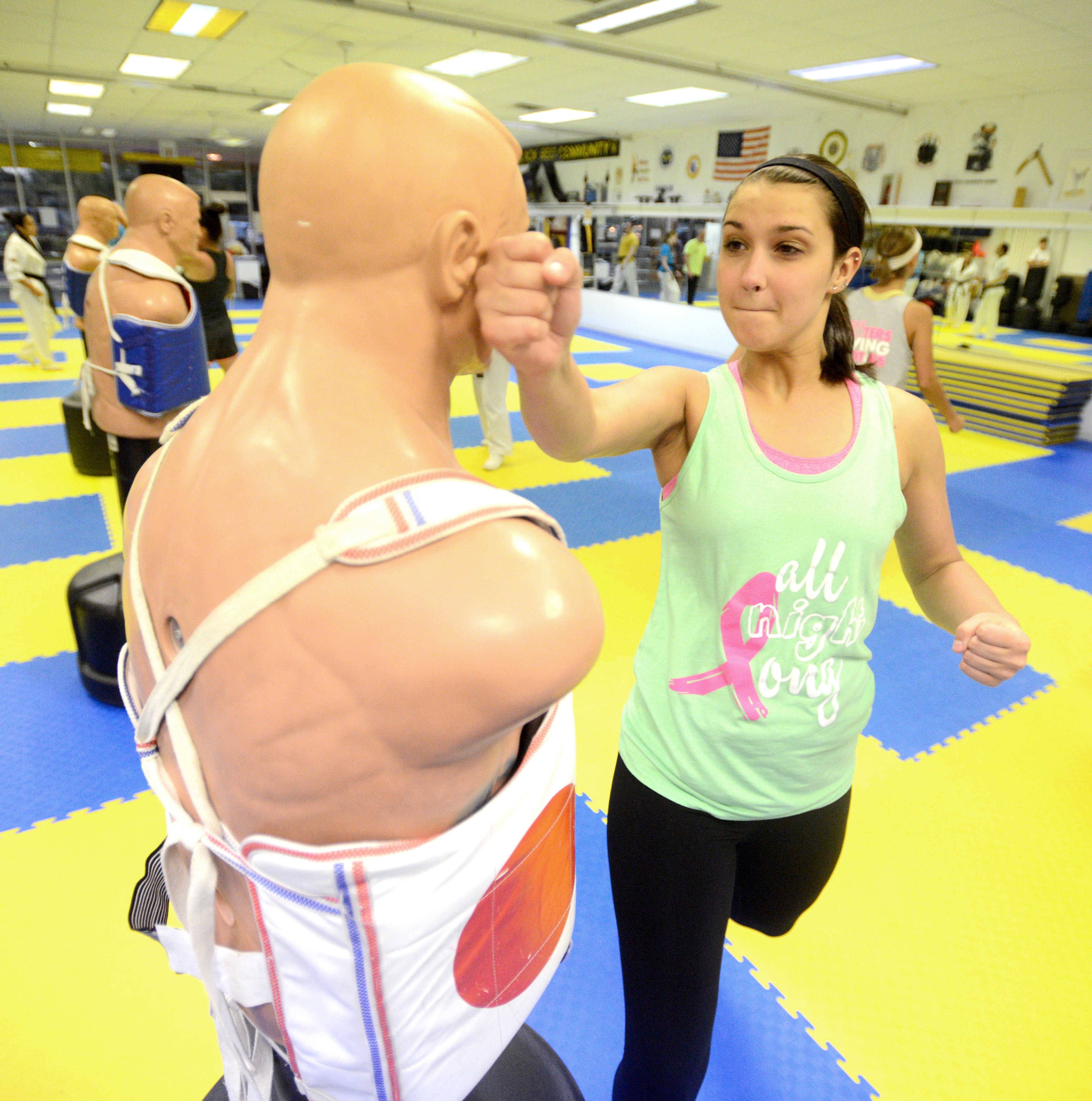 Shannon Wittel of Palatine practices a backhand punch during a women's self-defense class at J.P. Wood Martial Arts America in Palatine.