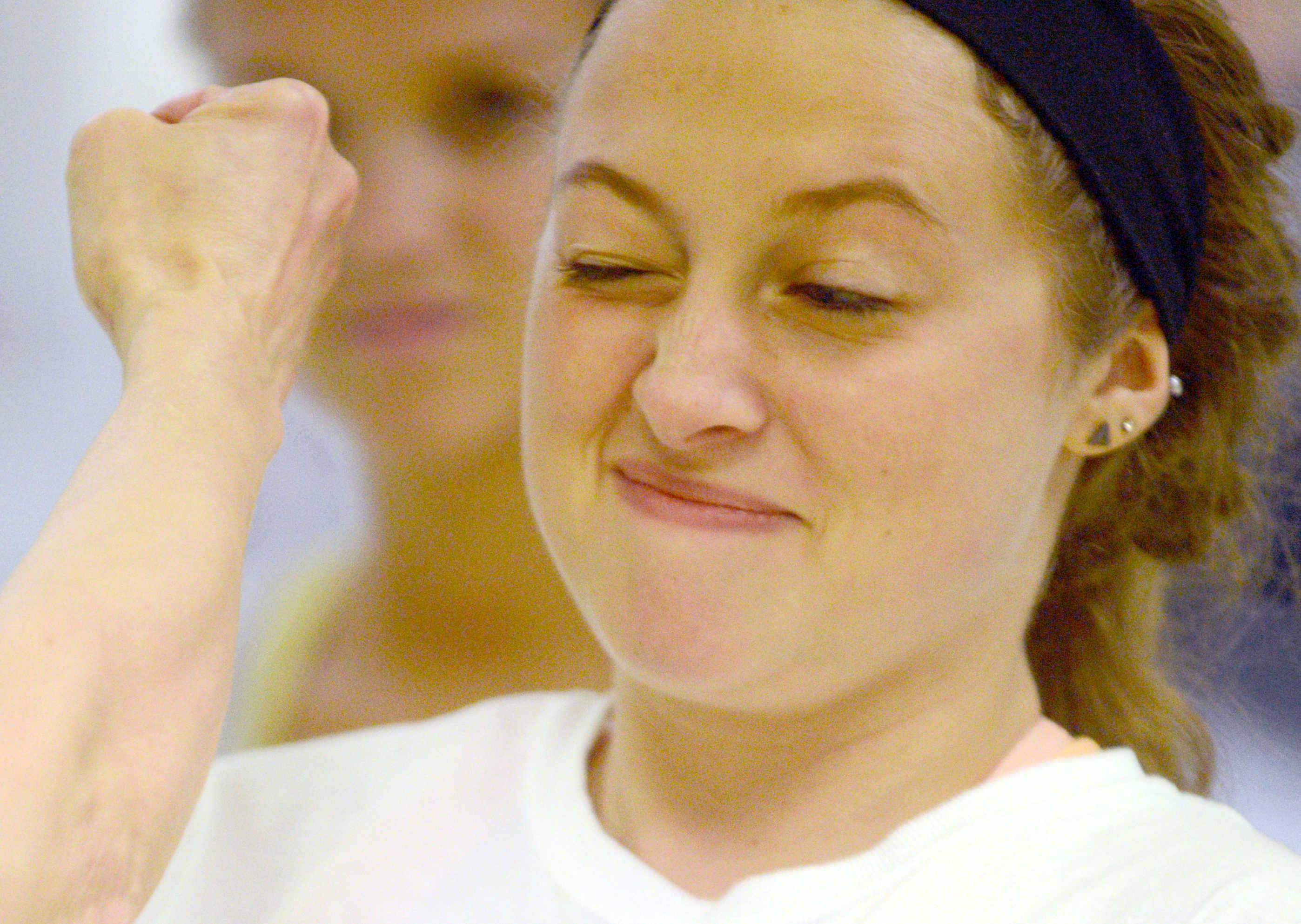 Taylor Delapa of Palatine winces at a punch during a women's self-defense class at J.P. Wood Martial Arts America.