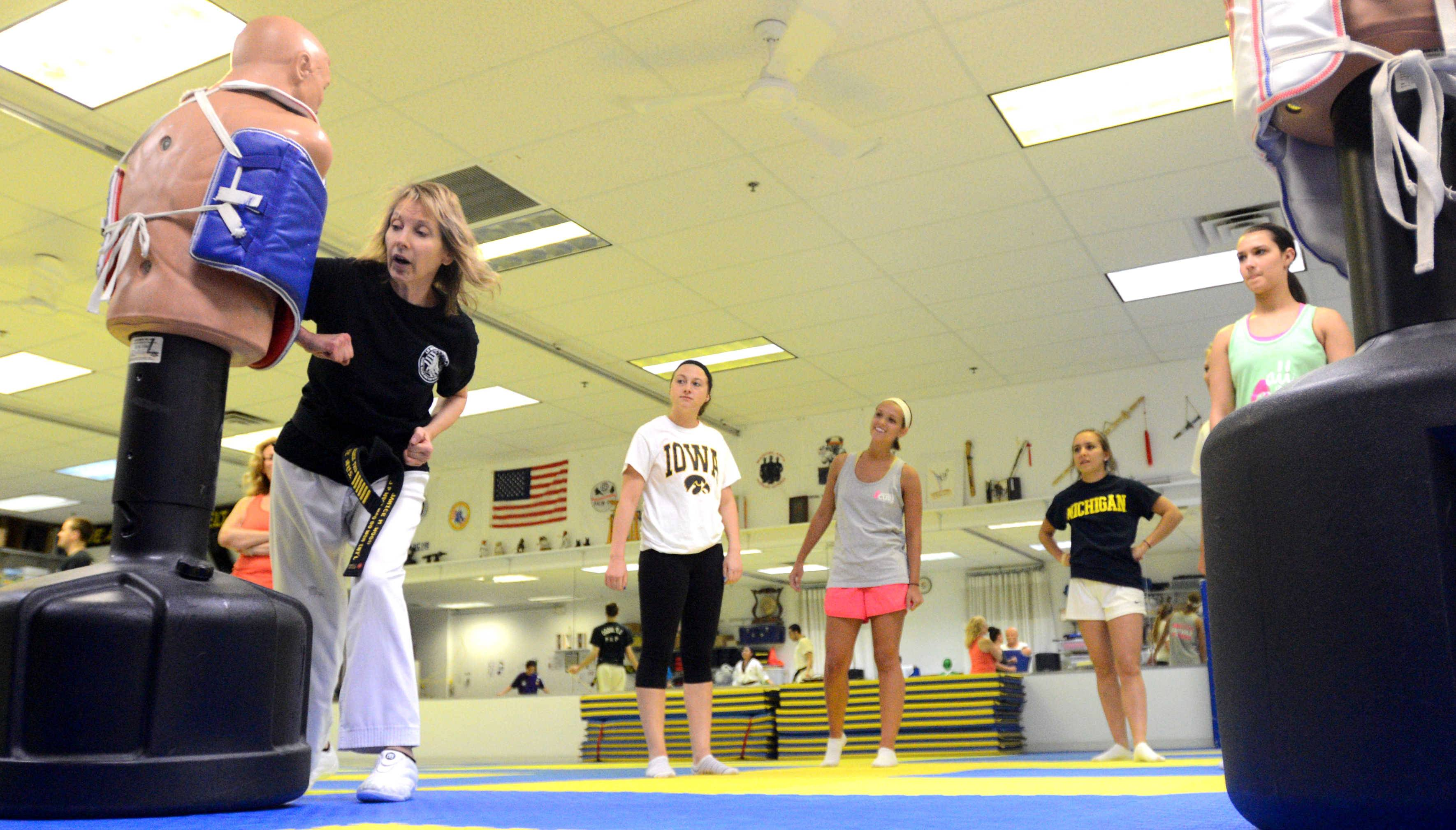 Instructor Jan Wood leads lessons in blocking aggression during a women's self-defense class at J.P. Wood Martial Arts America in Palatine.