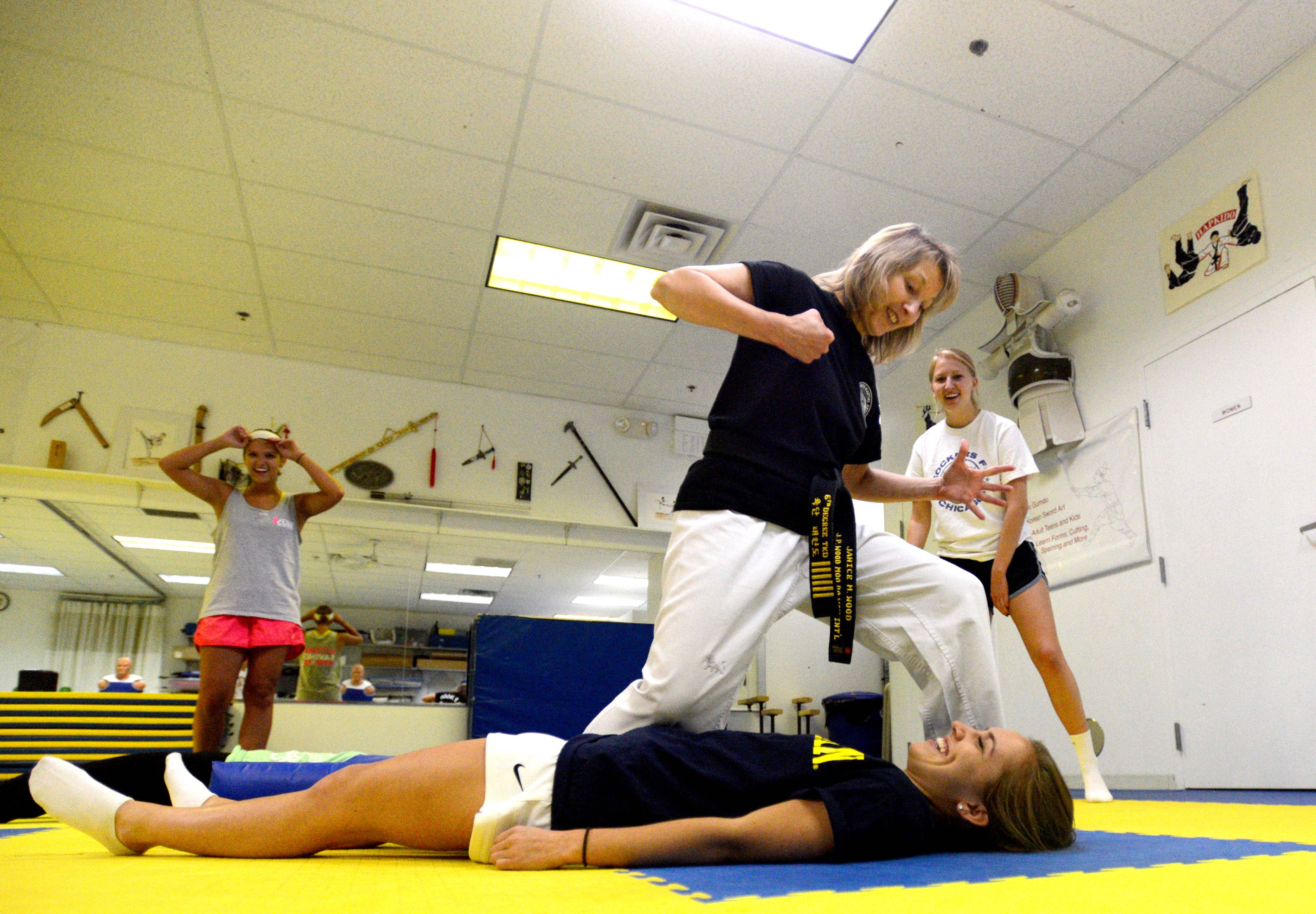 Instructor Jan Wood shows her might over Tracy Bourgon of Palatine during a women's self-defense class.