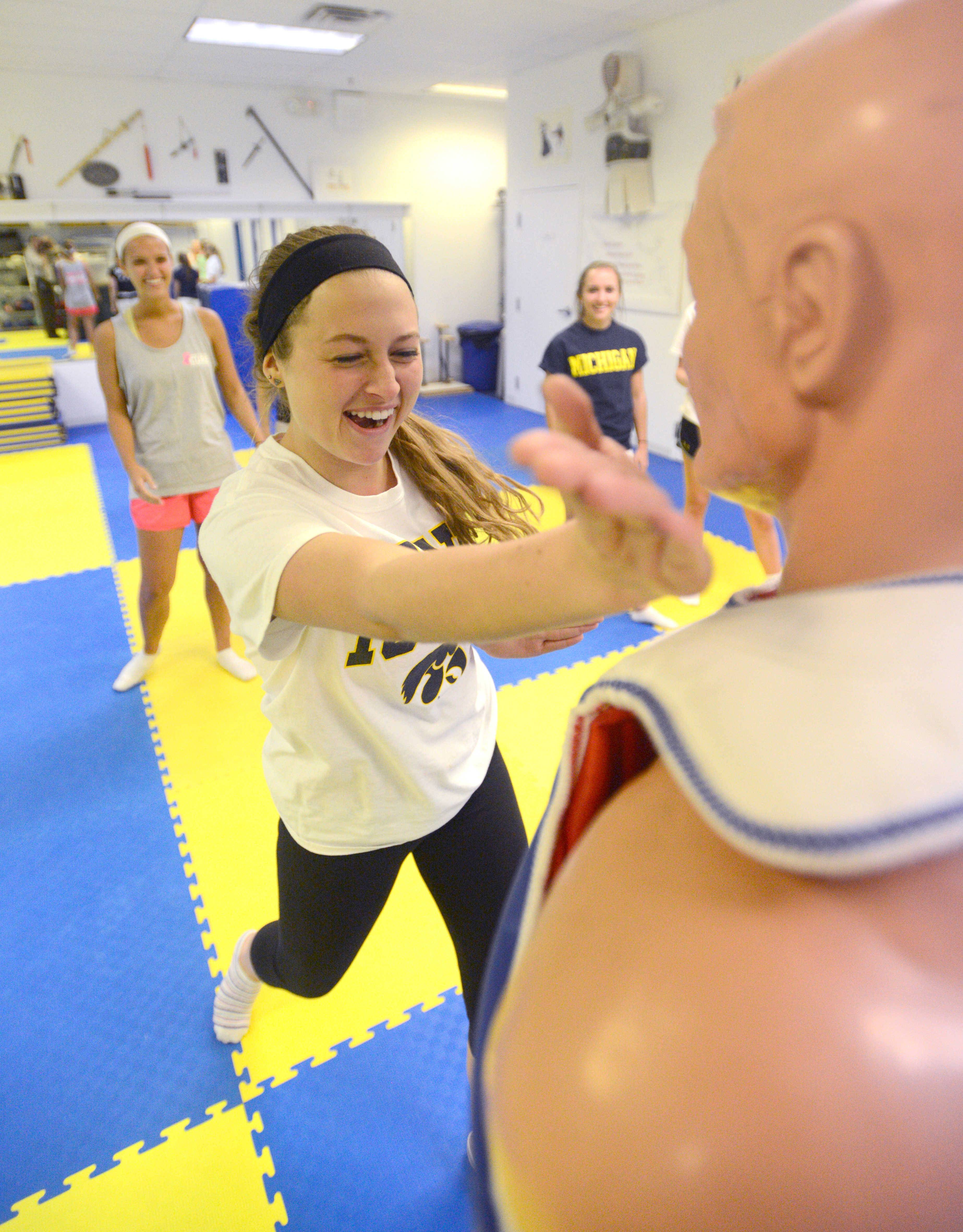 "Taylor Delapa of Palatine practices using her hands as ""knives"" during a women's self-defense class."