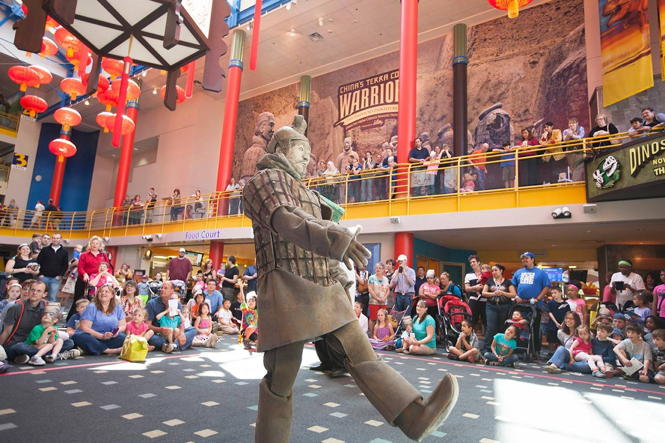 Eight of several thousand unearthed Terra Cotta Warrior statues, created to guard the tomb of China's first emporer, are on display through November at the Children's Museum of Indianapolis.