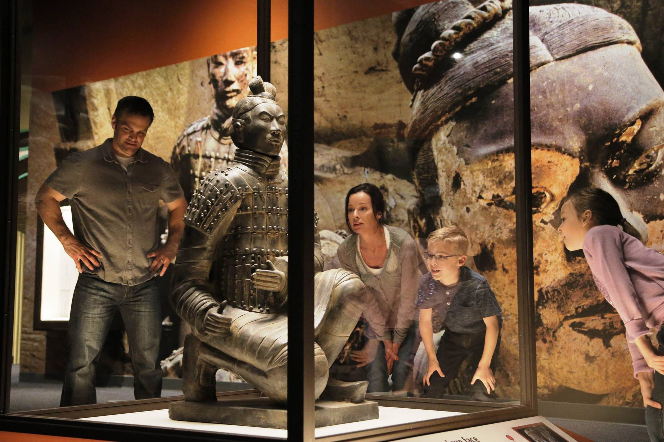 Eight of several thousand unearthed Terra Cotta Warrior statues, created to guard the tomb of China's first emperor, are on display through November at the Children's Museum of Indianapolis.