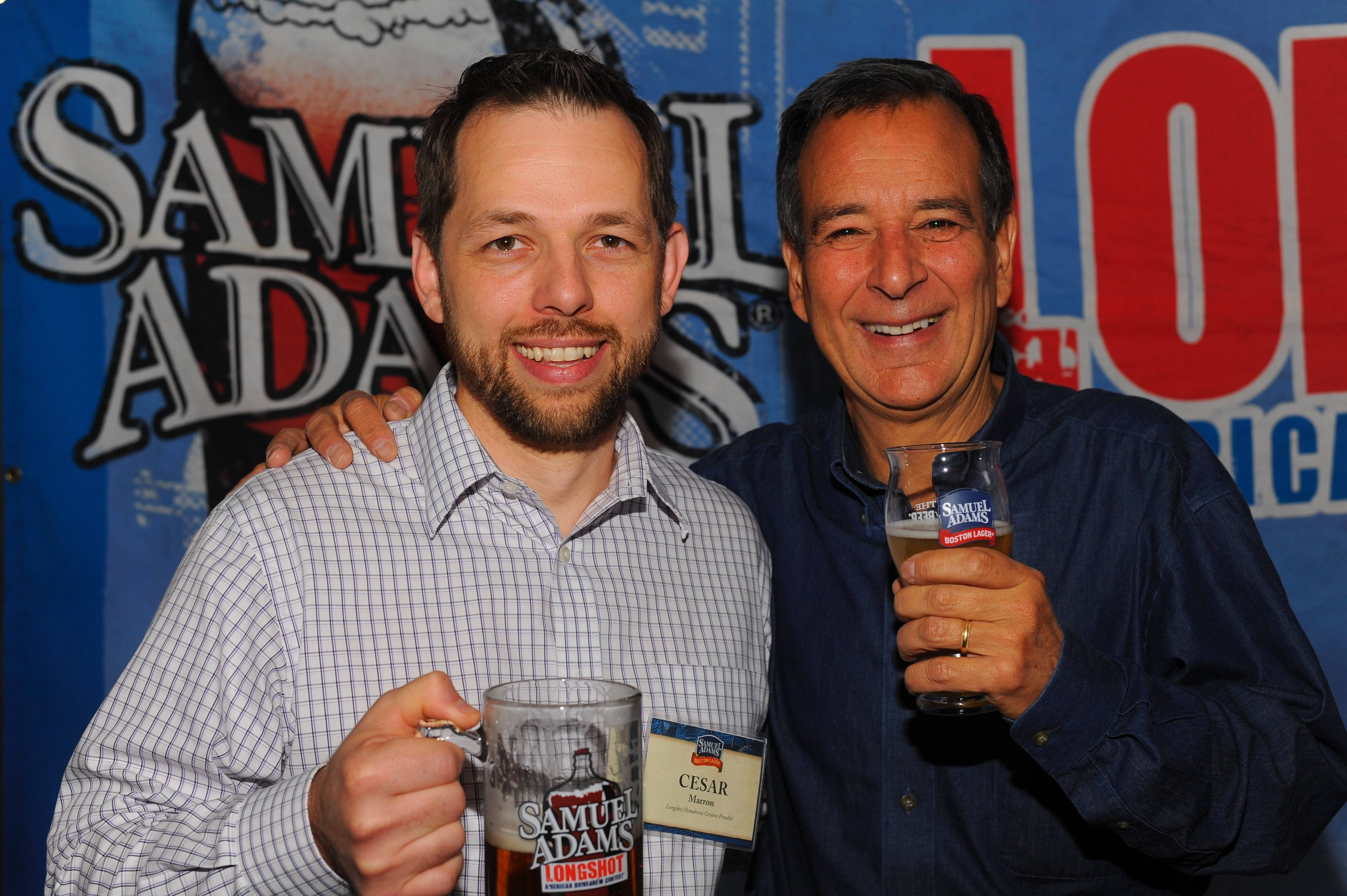 Cesar Marron, left, celebrates winning the LongShot Homebrew Contest with Samuel Adams founder Jim Koch.