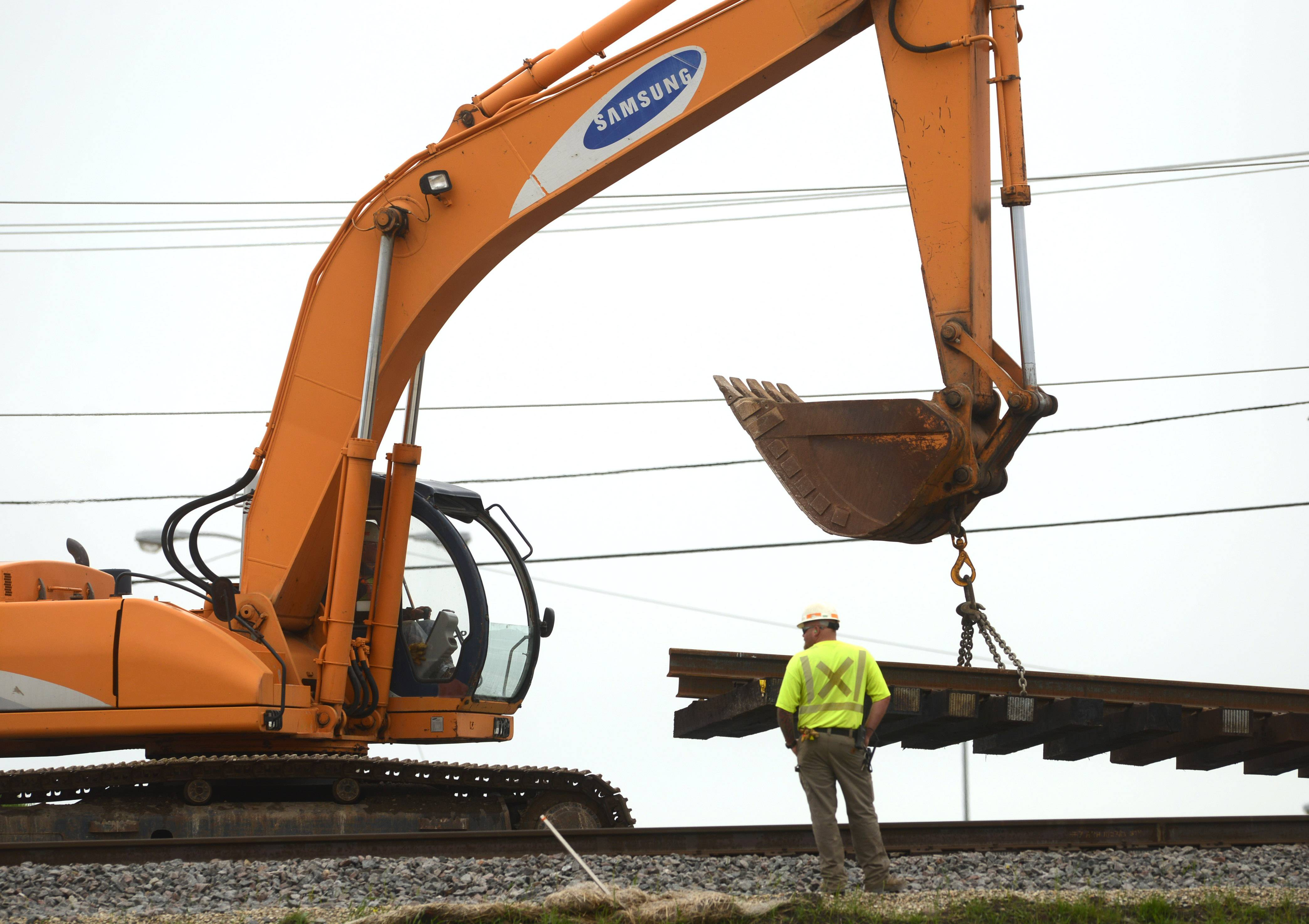 Crews move sections of train track Wednesday along Route 83 just north of Rollins Road in Round Lake Beach. Rollins Road will be closed for about three days beginning Friday for track construction.
