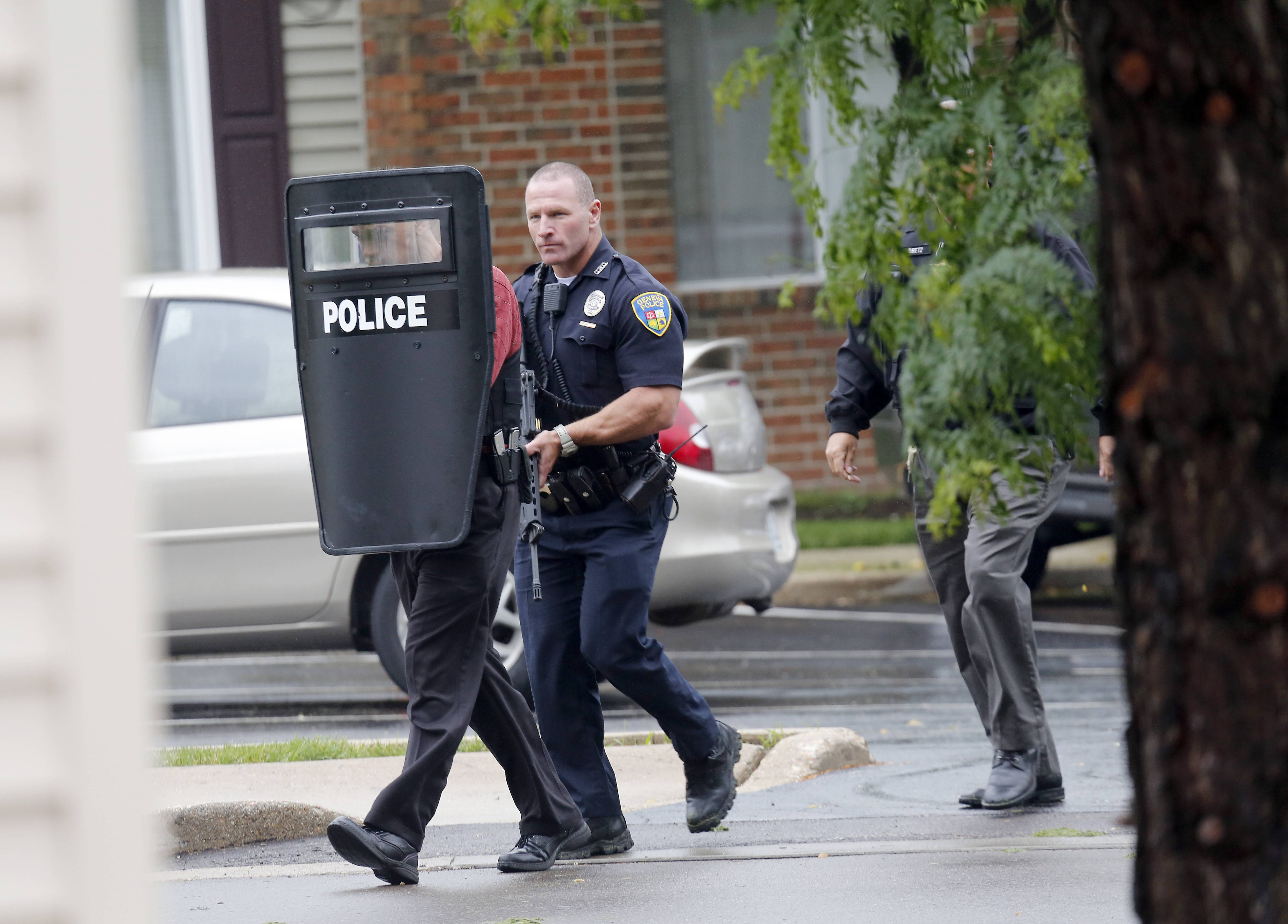 Officers from St. Charles, Geneva, Batavia and Sugar Grove move into position Wednesday at Ashford At Geneva Apartment Homes to apprehend two people wanted for questioning related to a series of local robberies.