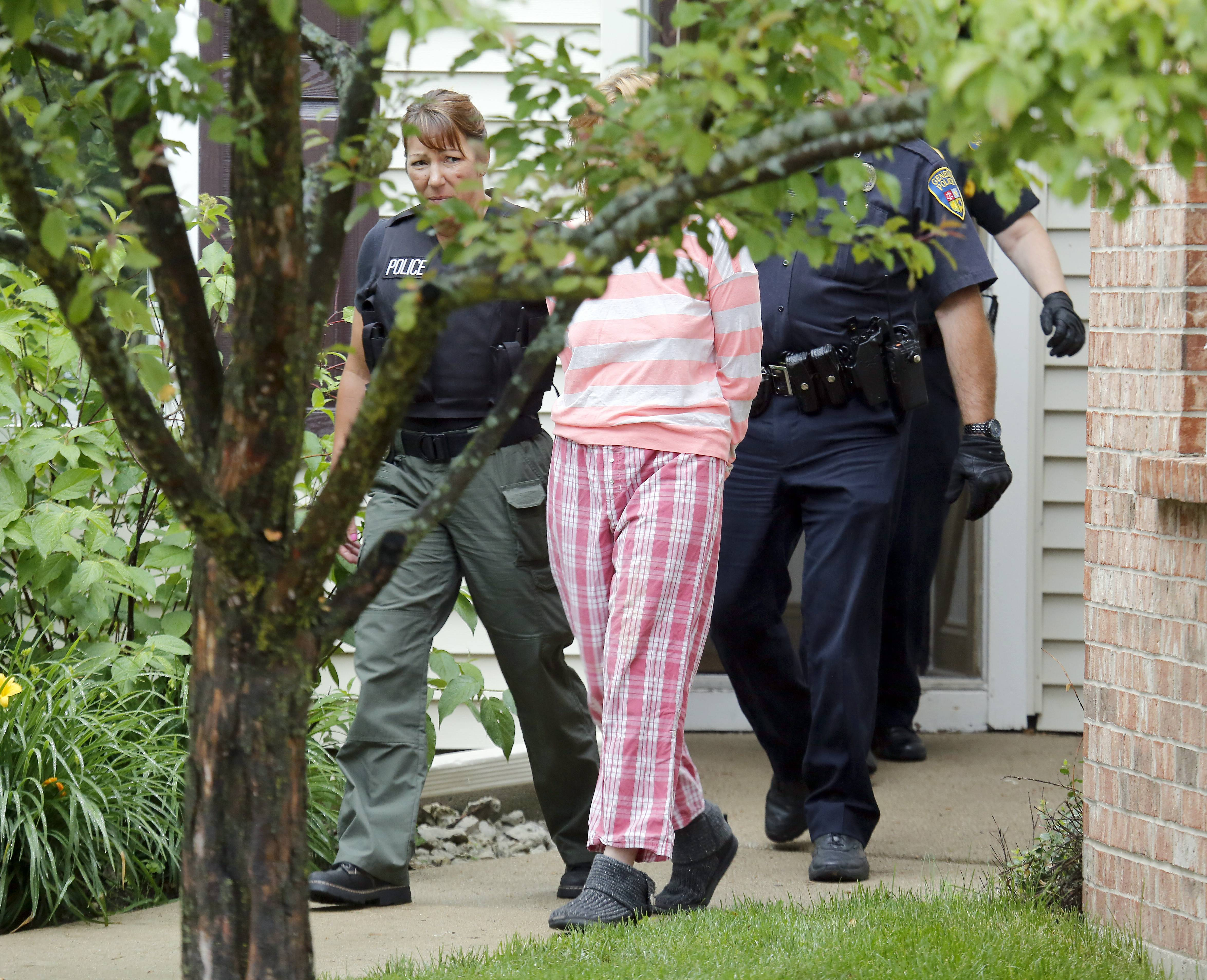 Police remove Kayla N. Magnuson, 22, of 353 Brittany Court in Geneva, from a building Wednesday at Ashford At Geneva Apartment Homes. Police said they were investigating her in connection with a series of robberies, the most recent of which was earlier in the day in Batavia.