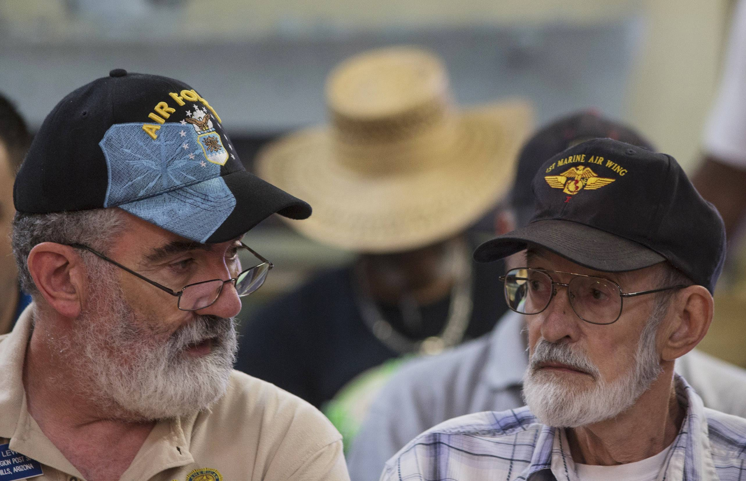 Vietnam veteran Gene Stoesser, right, talks with Veterans Crisis Command Center volunteer Chuck Lewis, left, while he waits for an appointment Tuesday, June 10, 2014, at American Legion Post 1 in Phoenix.