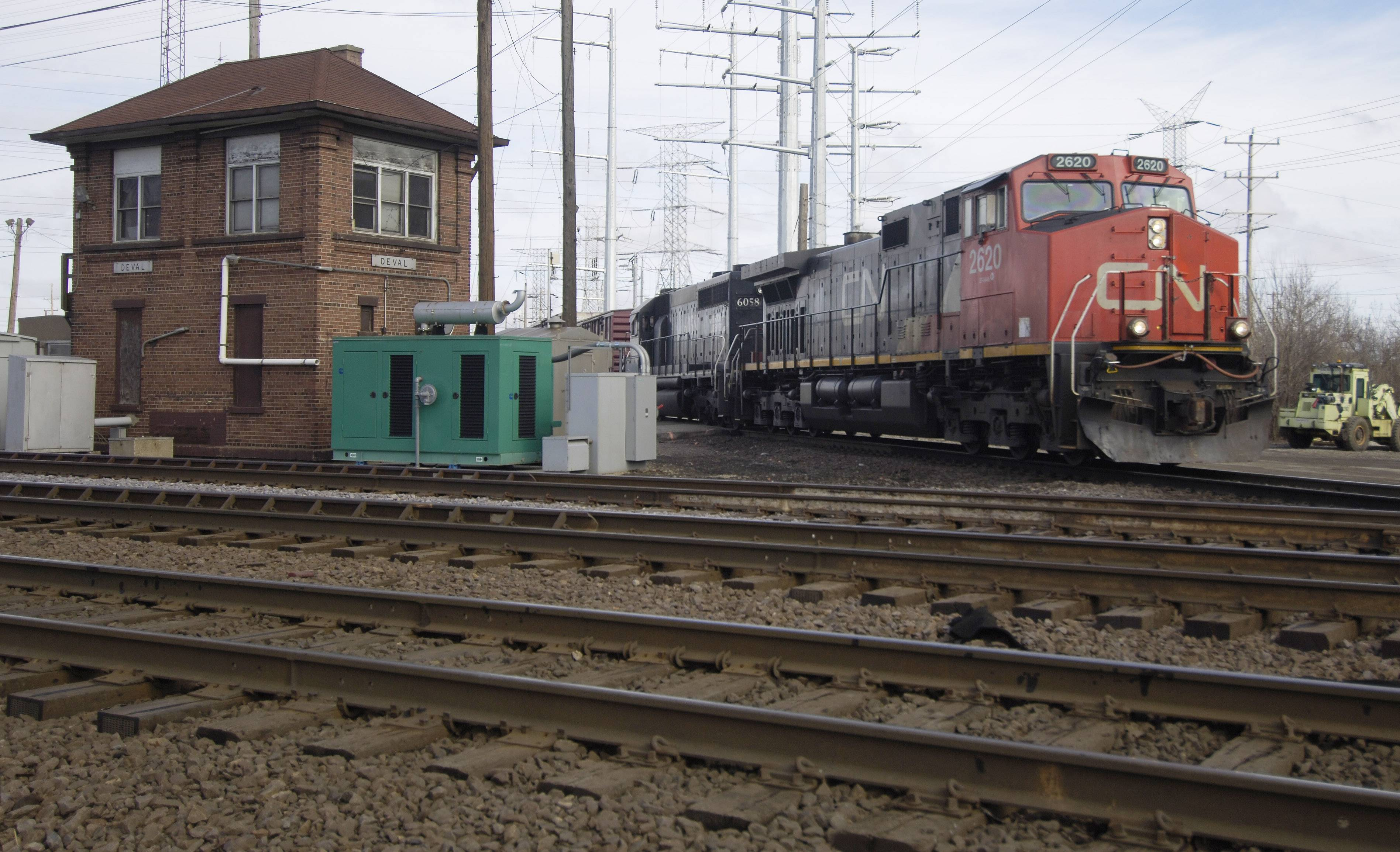 A southbound Canadian National train crosses the Metra/Union Pacific Notrthwest line at Deval tower in Des Plaines.