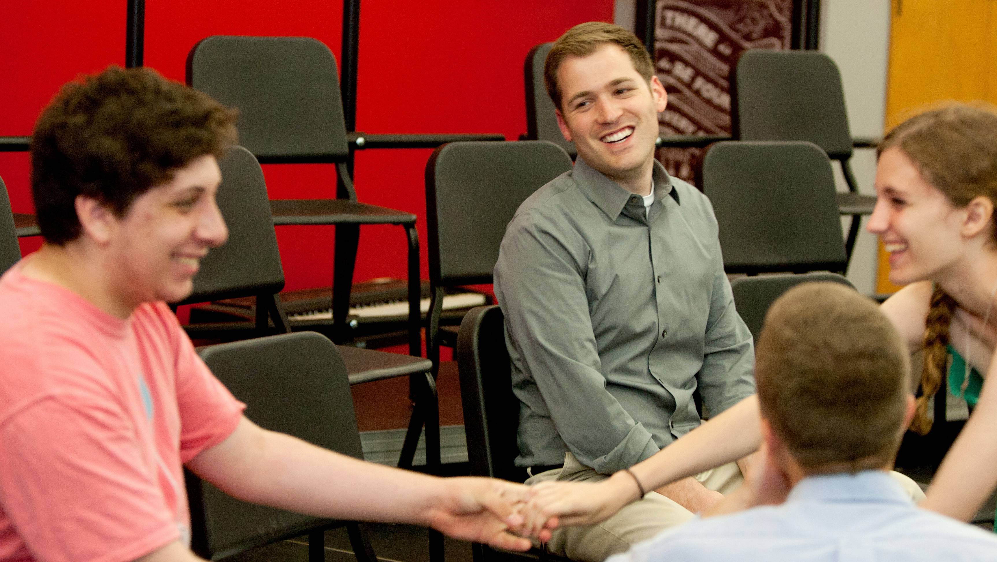 For two consecutive years, Glenbard East choir director Brandon Catt, center, has been nominated for the Music Educator Award given by the Grammy Foundation and the Recording Academy. He recently met with students Frank Cesario, Luke Young and Rachel Callaly.