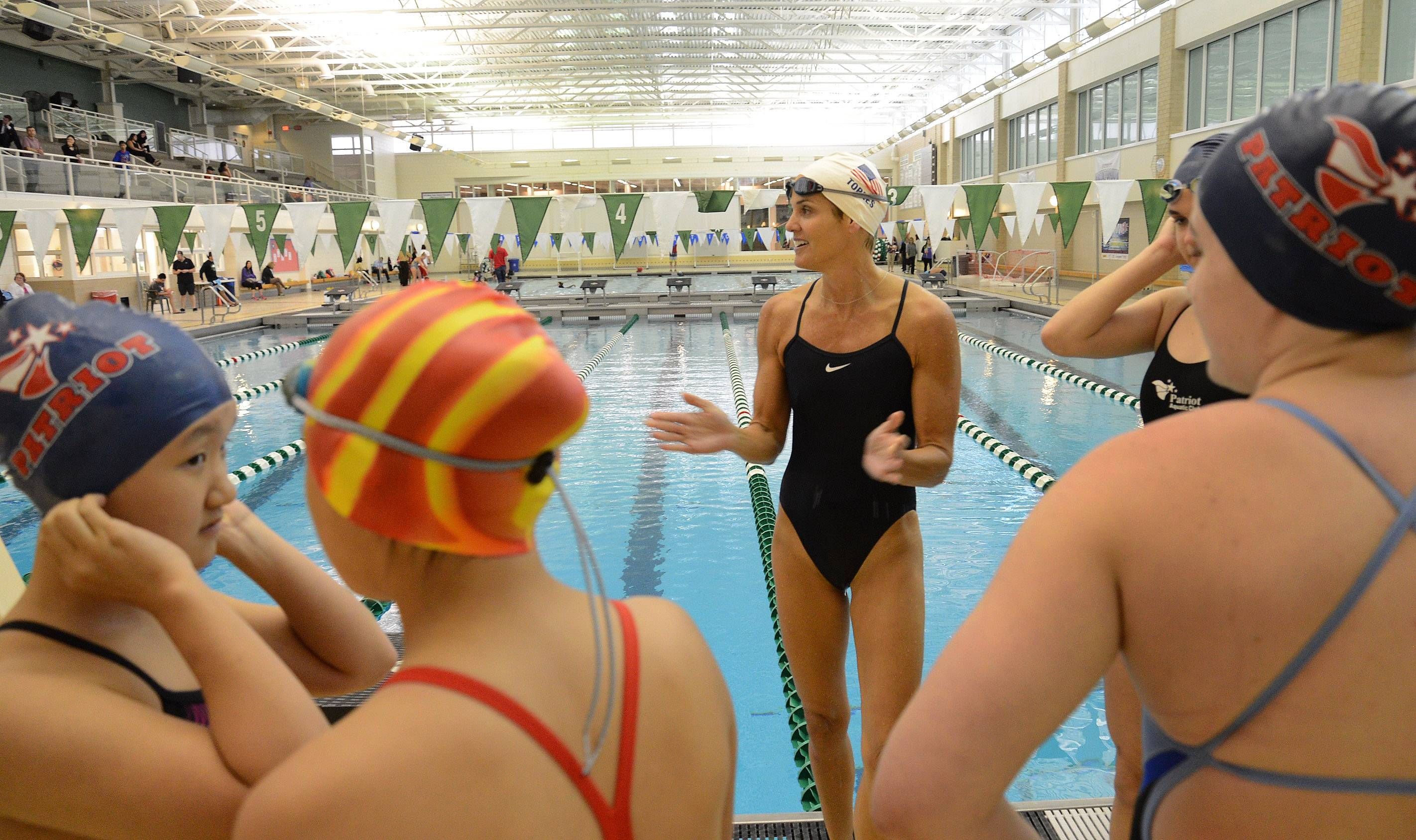 Olympic swimmer Dara Torres meets with swimmers before taking laps with them while visiting Stevenson High School Tuesday night to talk about the dangers of bacterial meningitis.