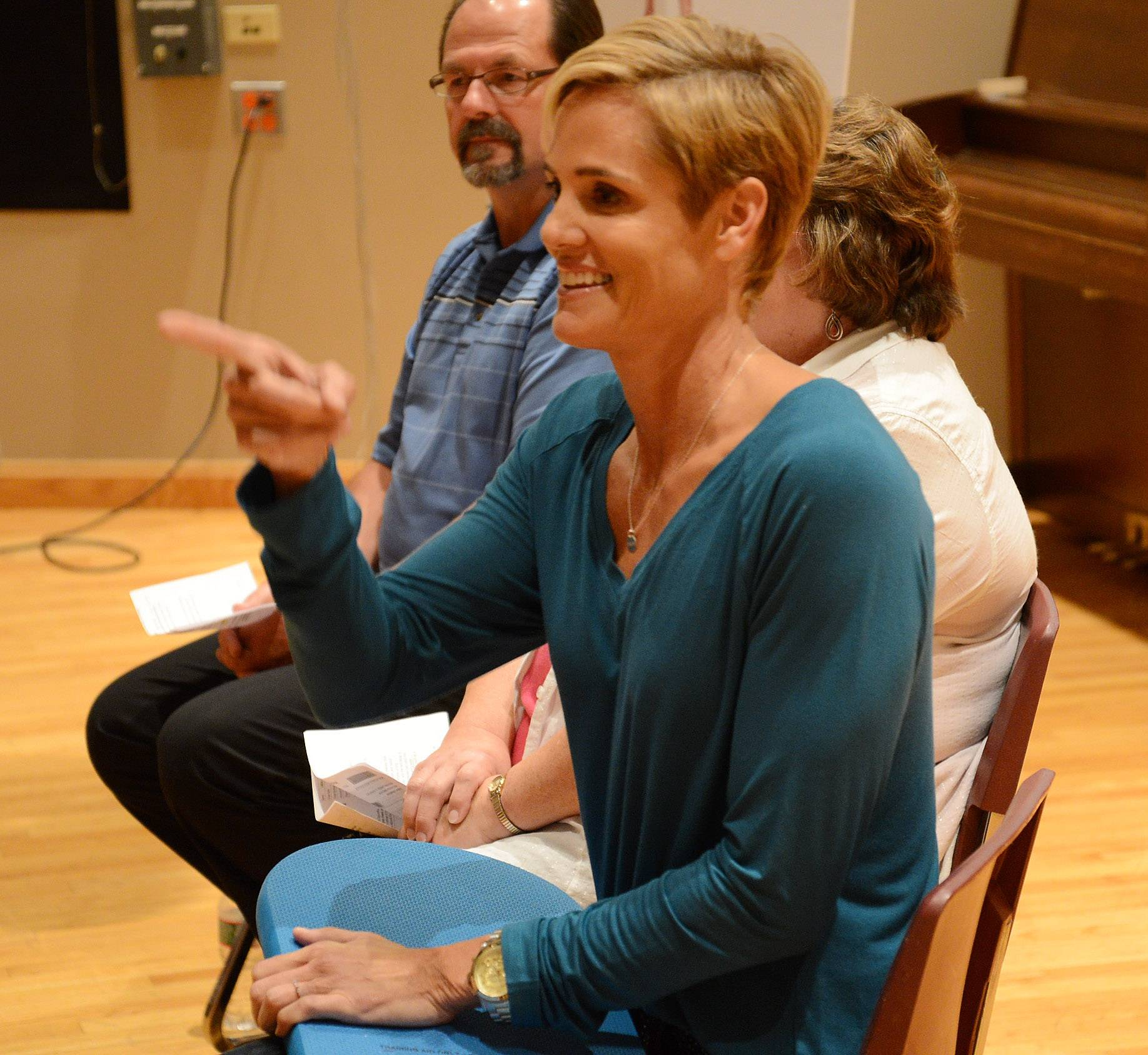 Olympic swimmer Dara Torres takes from the audience before taking laps with swimmers while visiting Stevenson High School Tuesday night to talk about the dangers of bacterial meningitis.