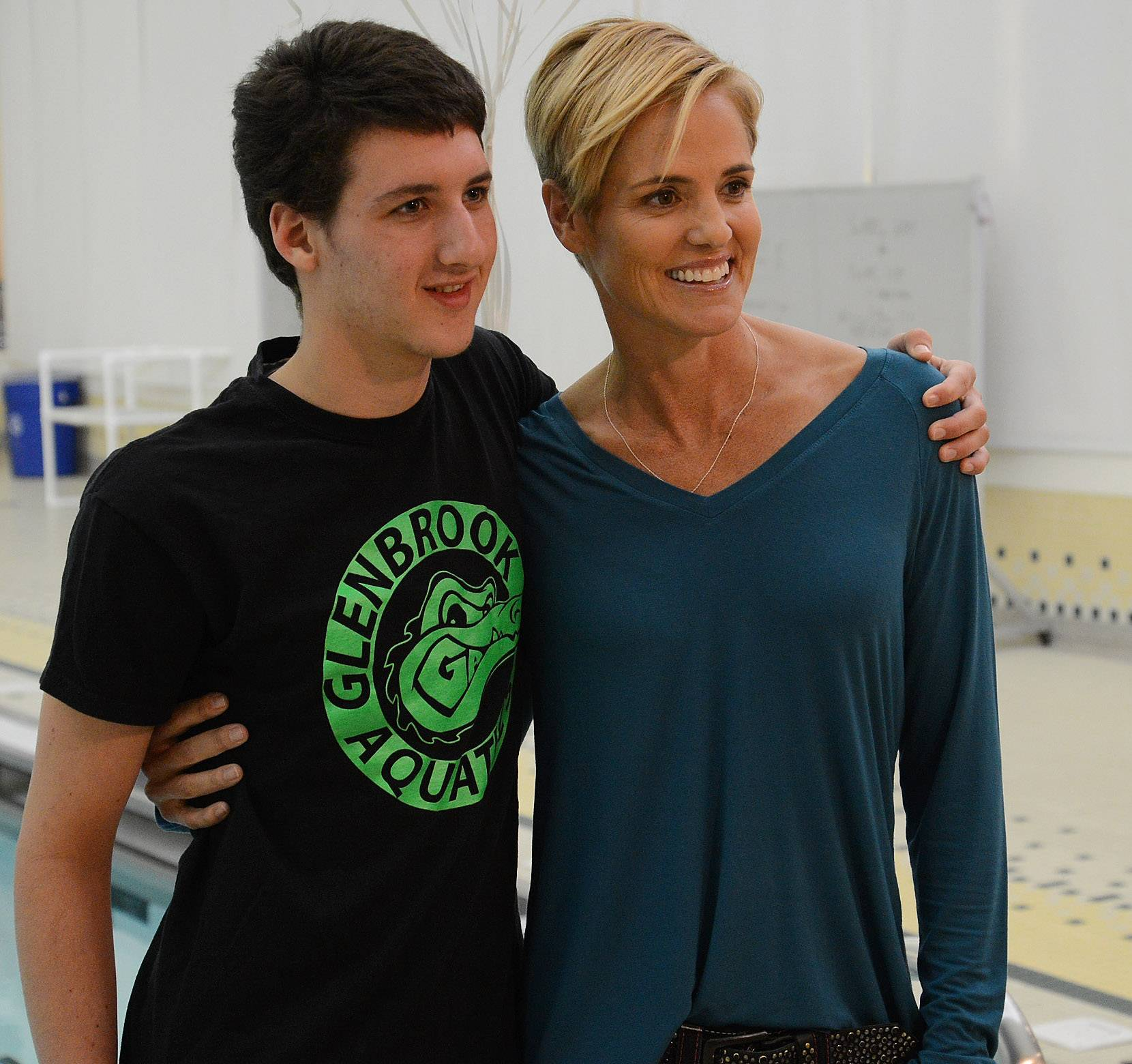 Sam Ehrlich gets his picture taken with Olympic swimmer Dara Torres prior to Torres talking about the dangers of bacterial meningitis while visiting Stevenson High School Tuesday night.