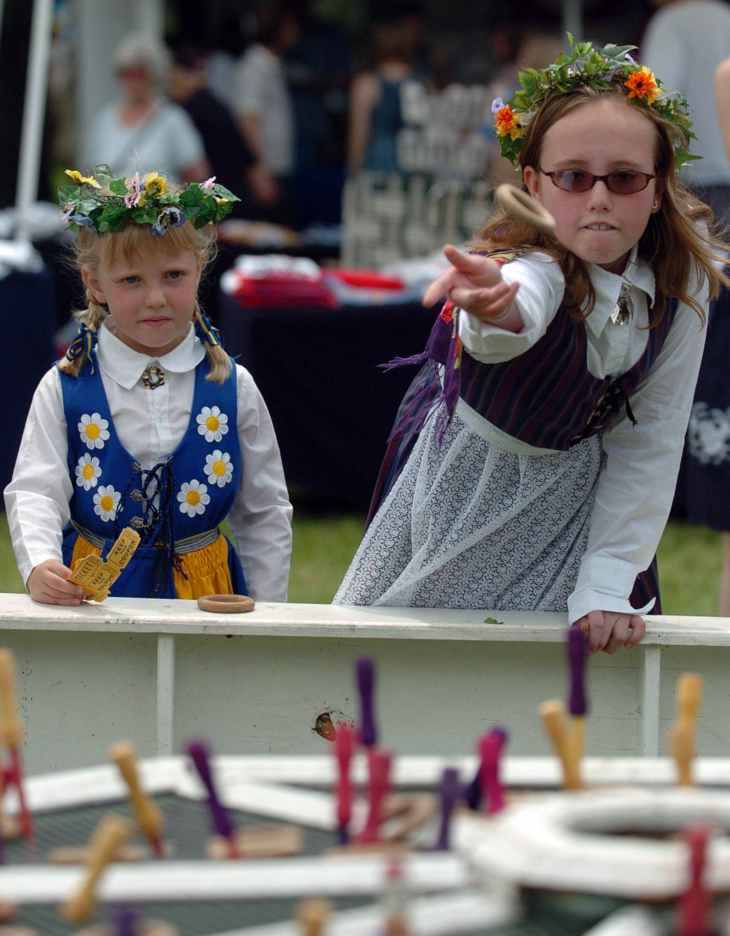 Members of the Swedish American Children's Choir play a ring toss game at a previous Swedish Day festival in Good Templar Park, Geneva. The choir will perform again this year at the festival.
