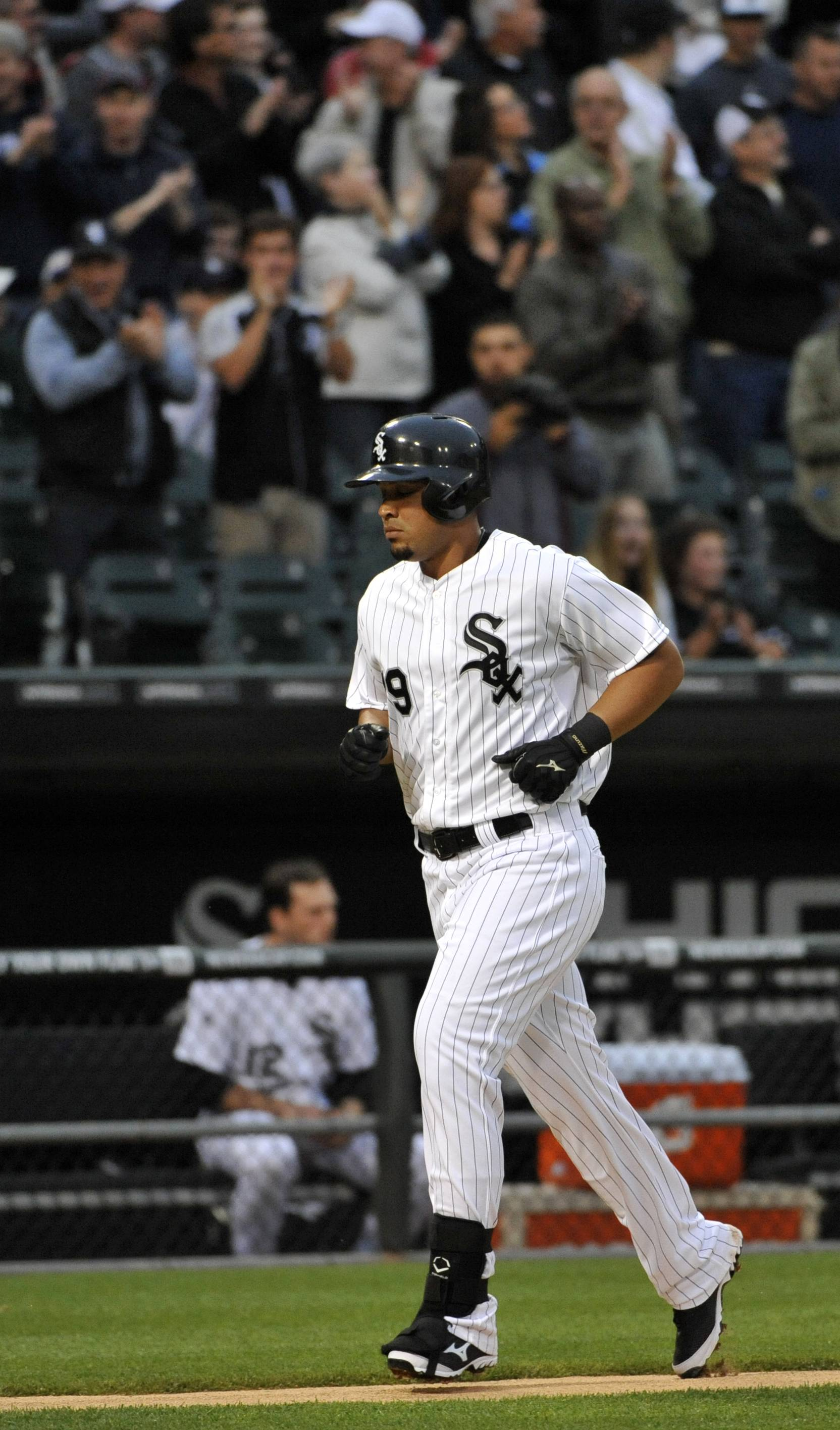 Chicago White Sox's Jose Abreu rounds the bases after hitting a solo home run during the second inning of a baseball game Wednesday against the Detroit Tigers in Chicago.