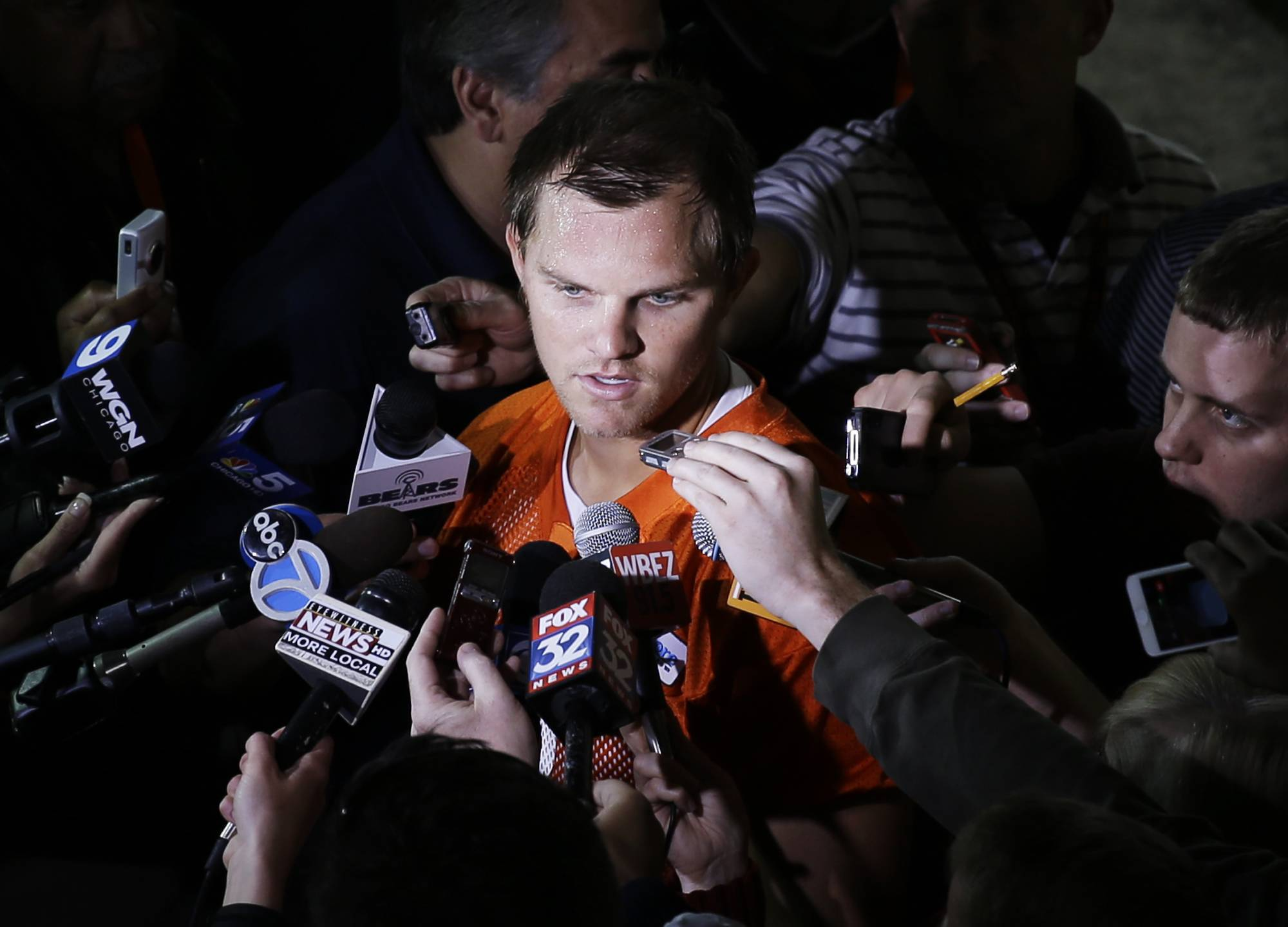 Chicago Bears quarterback Jimmy Clausen  talks to the media after NFL football practice Wednesday in Lake Forest, Ill..