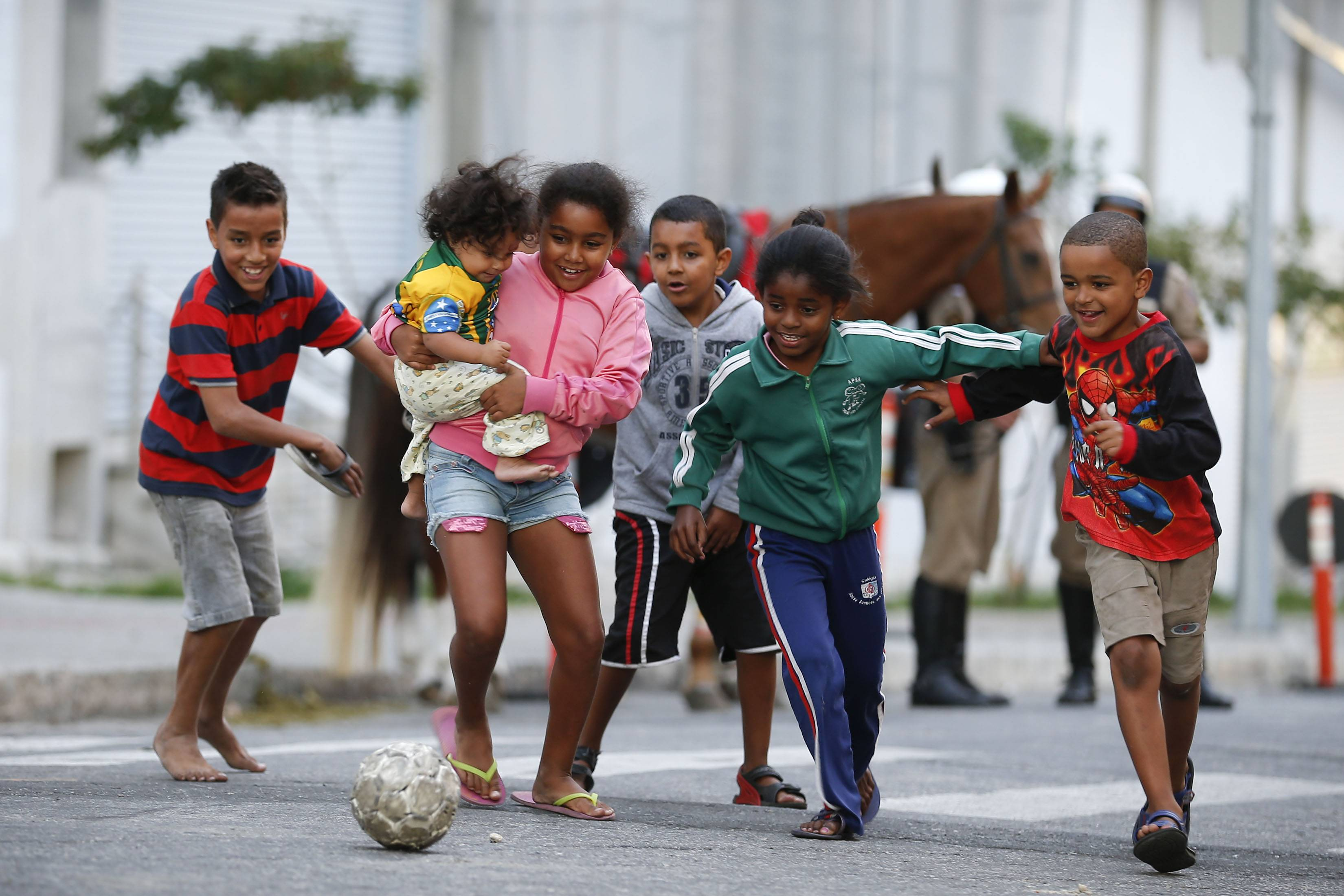 Children kick around a soccer ball Wednesday outside the Independencia Stadium in Belo Horizonte, Brazil. The 2014 World Cup is set to begin Thursday, with Brazil and Croatia competing in the opening match in Sao Paulo.